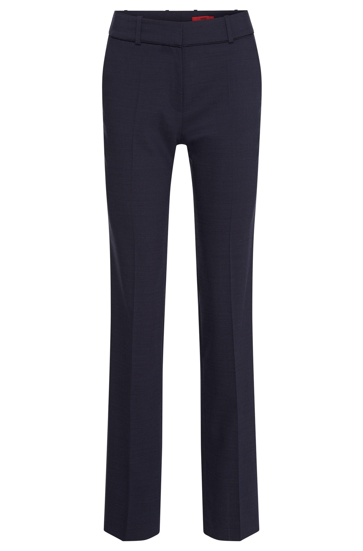 Pantalón regular fit con raya y lunares discretos en lana virgen elástica: 'Haluny'