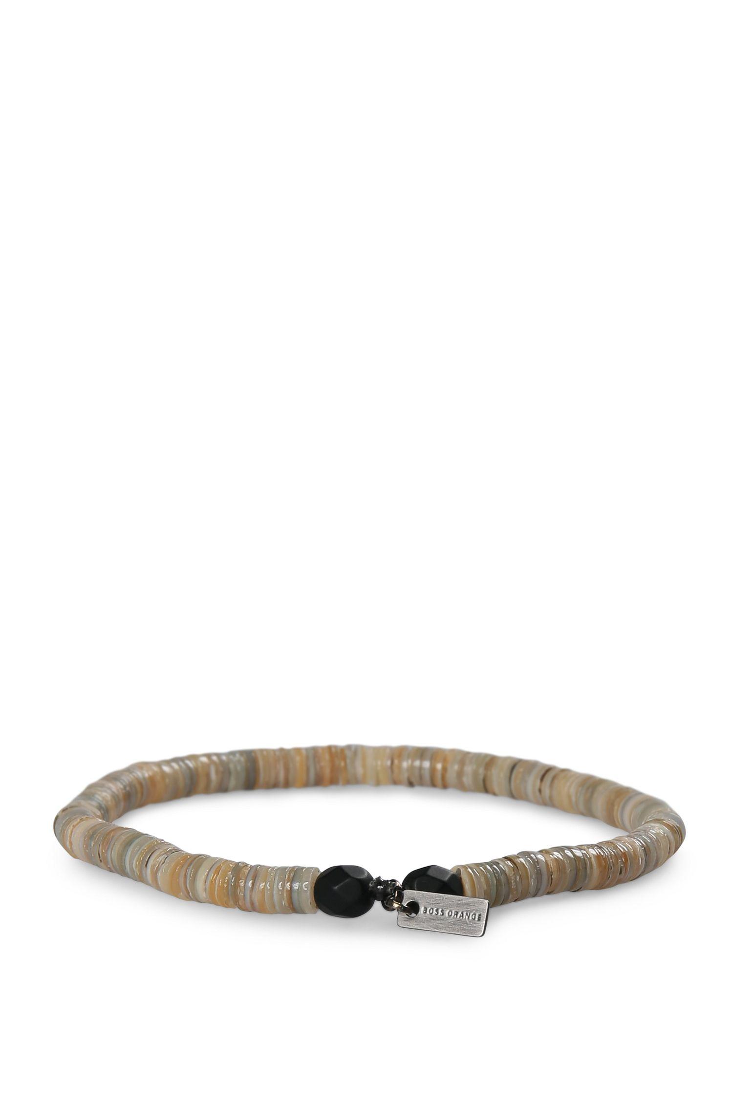 Bracciale di conchiglie elastico con perle in vetro: 'Mishell'