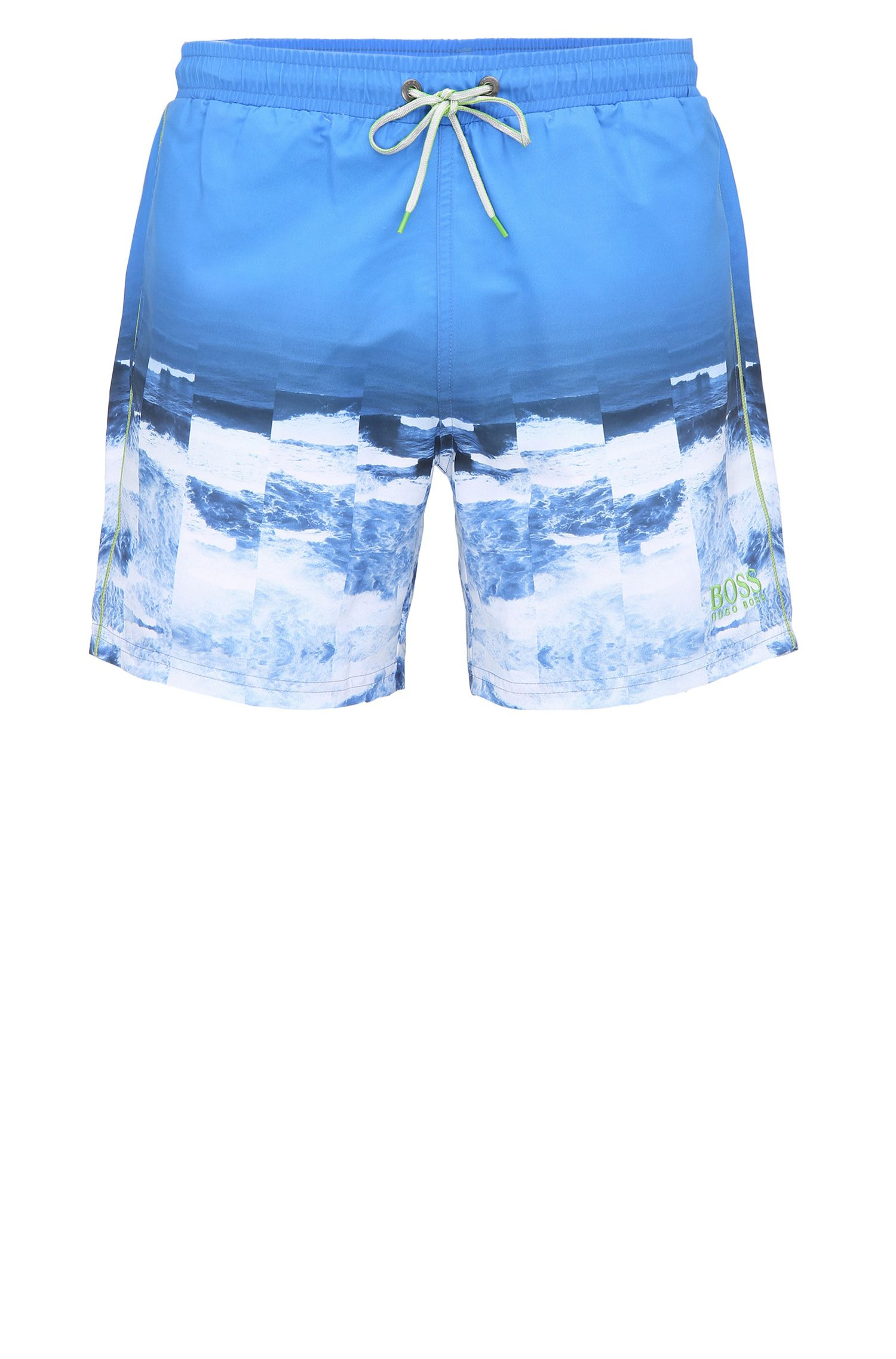 Swim shorts in material blend with a photo print: 'Velas'
