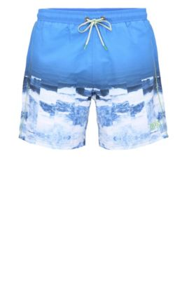 Swim shorts in material blend with a photo print: 'Velas', Blue