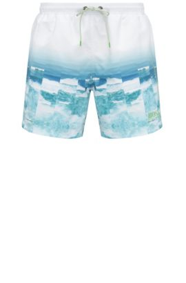Swim shorts in material blend with a photo print: 'Velas', Open Blue