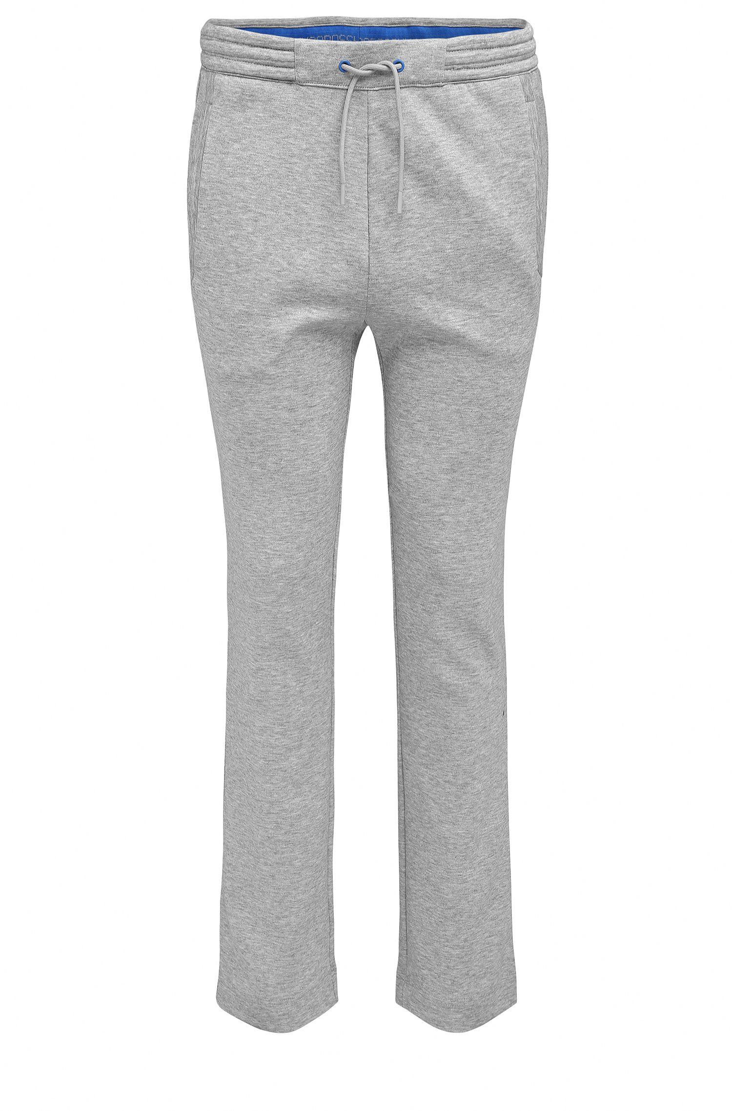 Pantaloni in cotone regular fit con orli aperti