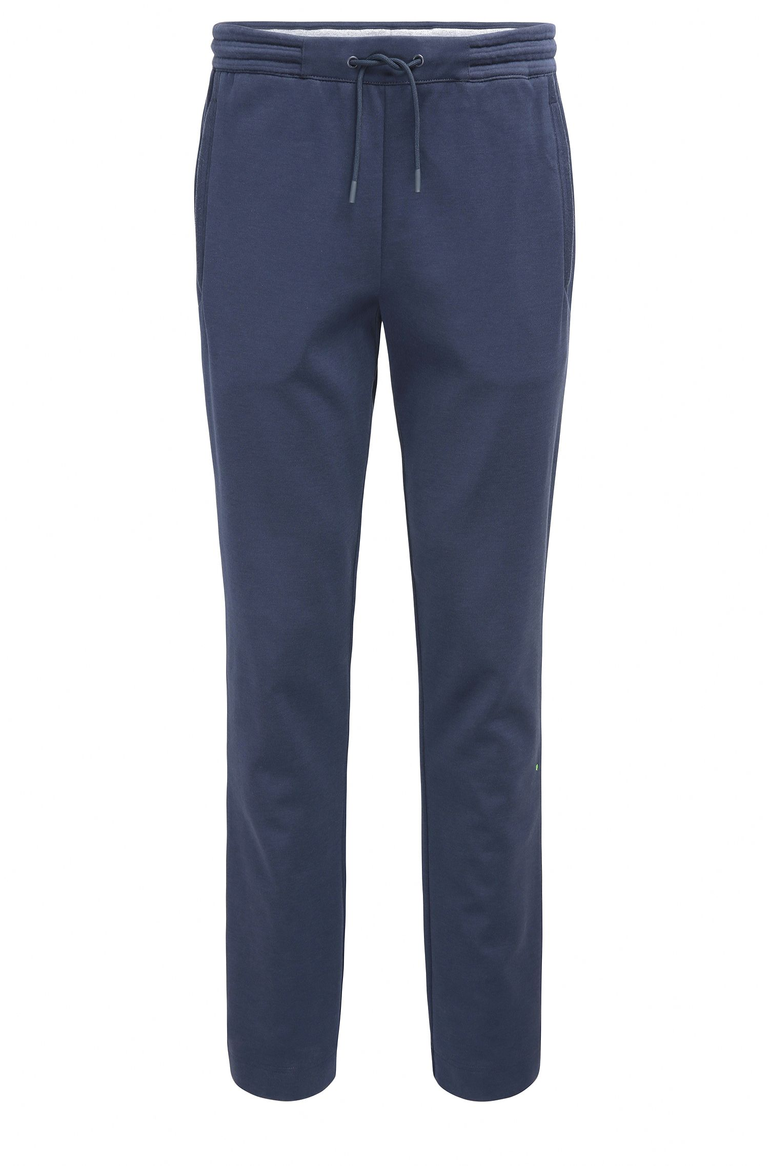 Pantaloni in cotone regular fit con orli aperti