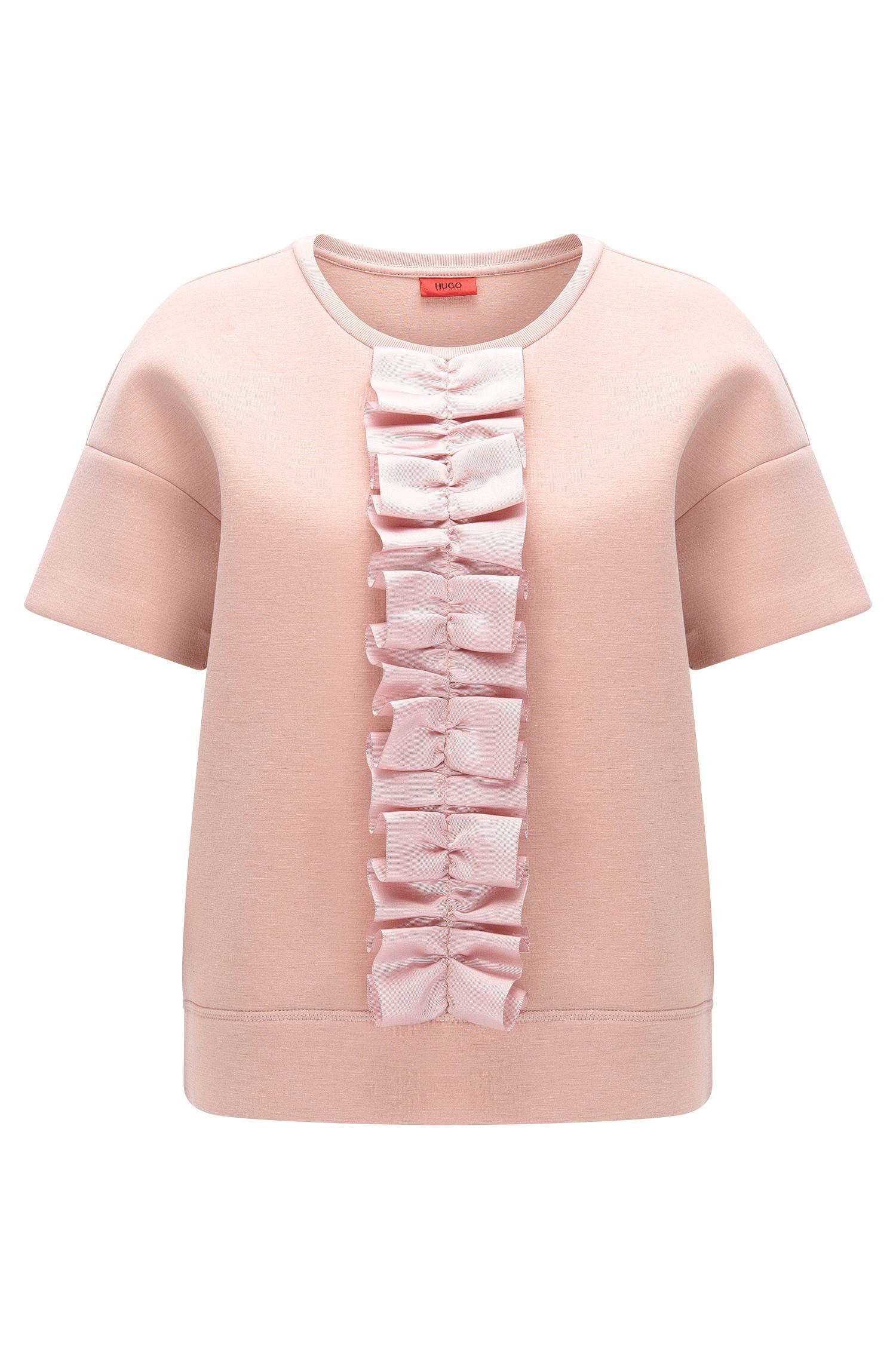 Camiseta oversize fit con una cinta de volante