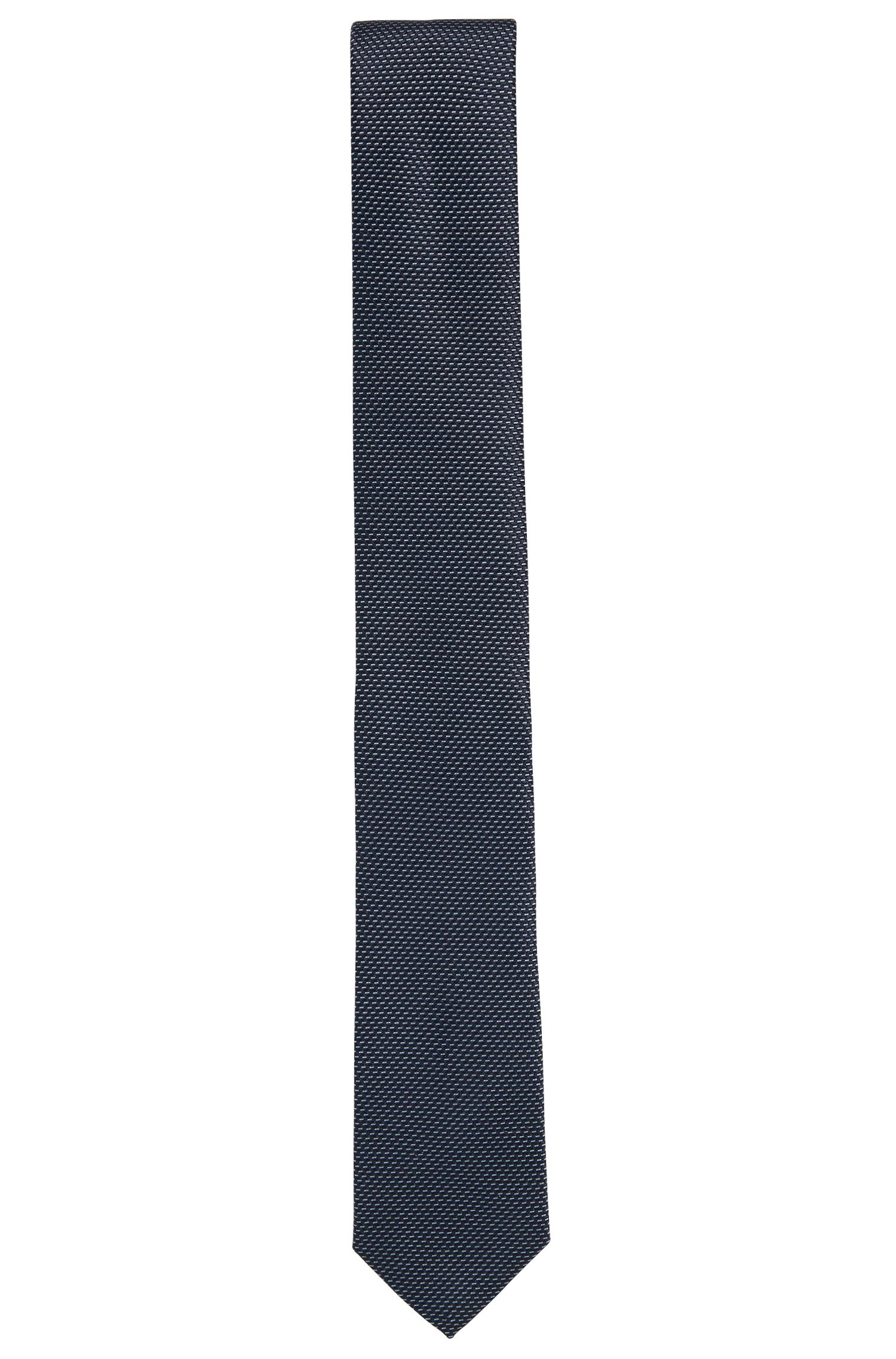 Silk tie in a two-tone micro pattern