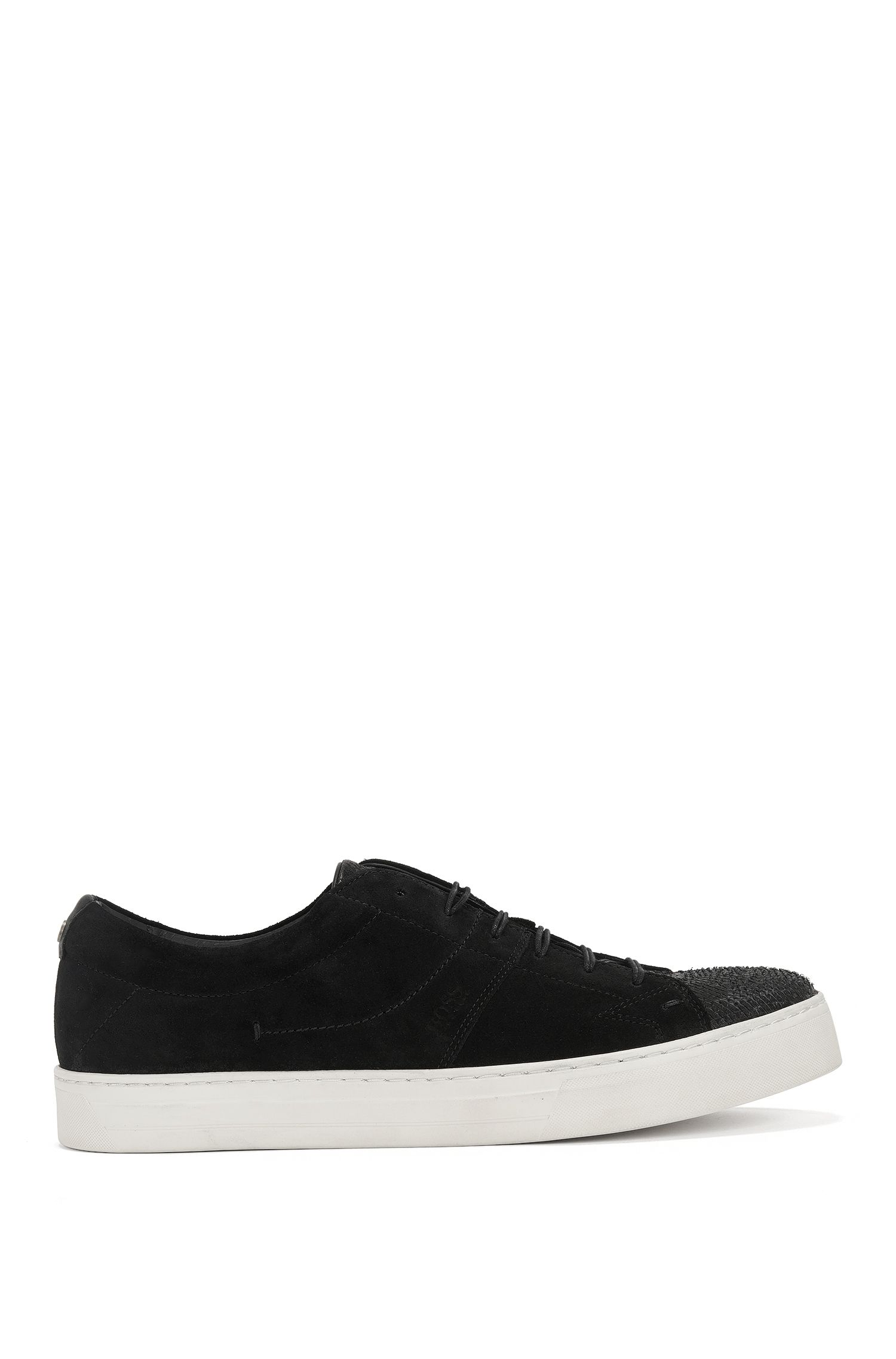 Tennis shoes in washed suede and lasered leather