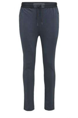 Slim-fit jersey trousers in technical fabric, Azul oscuro