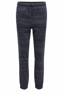 Pantalon Slim Fit en jersey, avec ornement haute densité, Bleu foncé