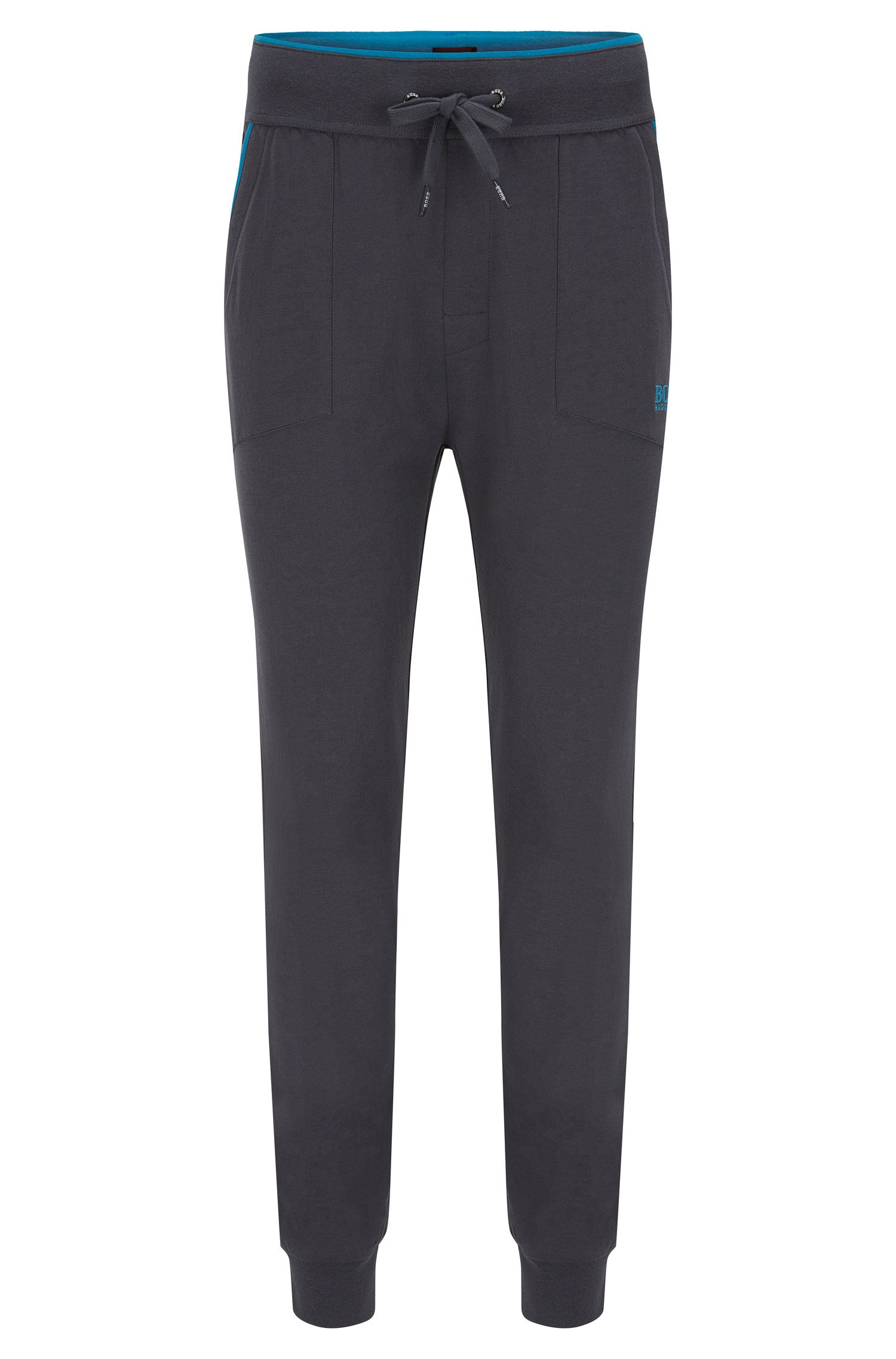 Jersey loungewear trousers with applied pockets and contrast piping