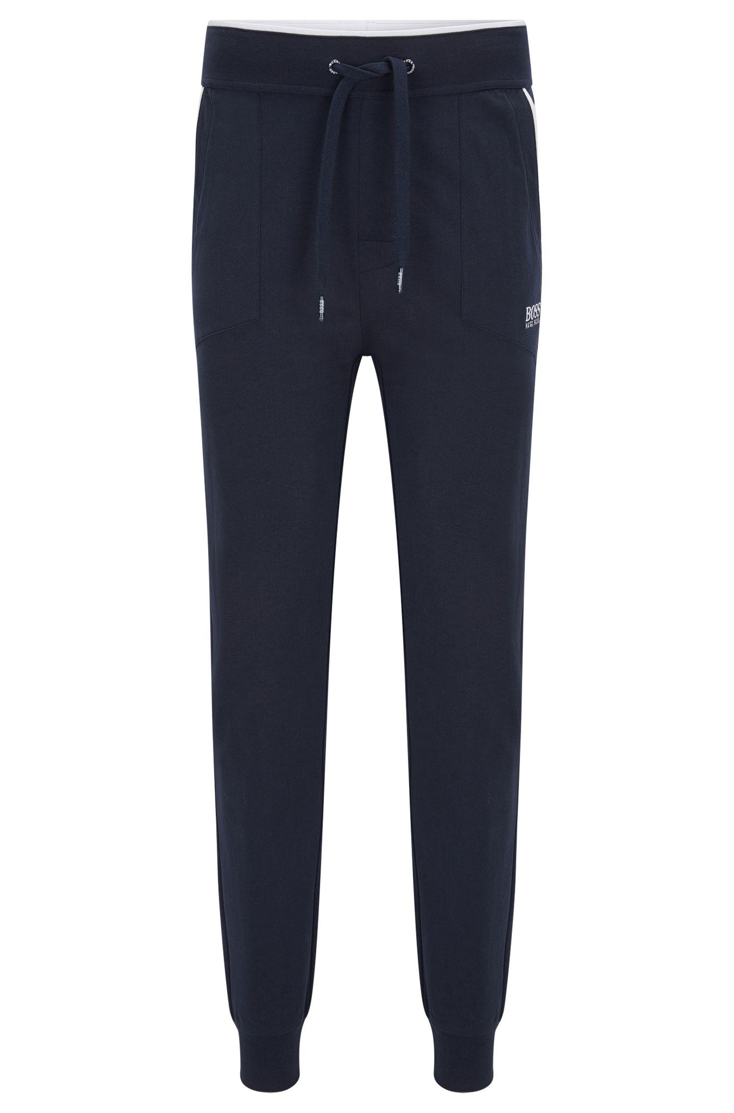 Loungewear-Hose aus Baumwolle mit aufgesetzten Taschen und kontrastfarbenen Paspeln