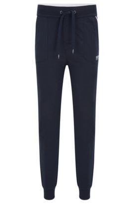 Loungebroek van jersey met opgezette zakken en contrasterende pipingbies, Donkerblauw
