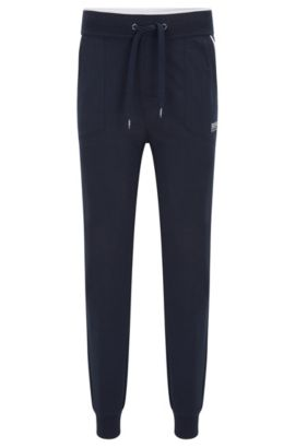Jersey loungewear trousers with applied pockets and contrast piping, Dark Blue