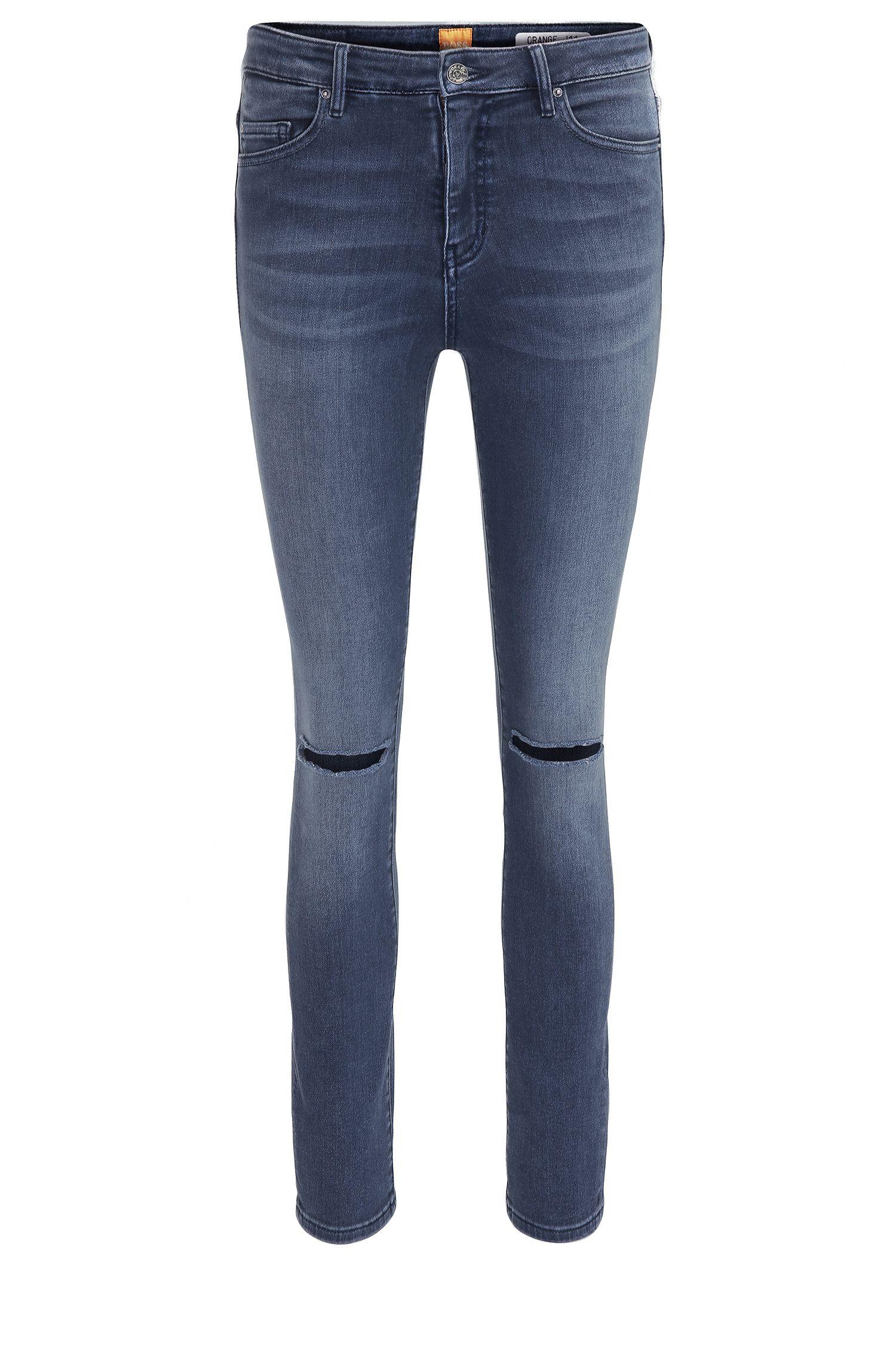 Jeans in denim super elasticizzato skinny fit alla caviglia con effetto usurato