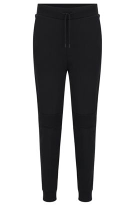 Regular-fit sweat trousers in interlock cotton, Black