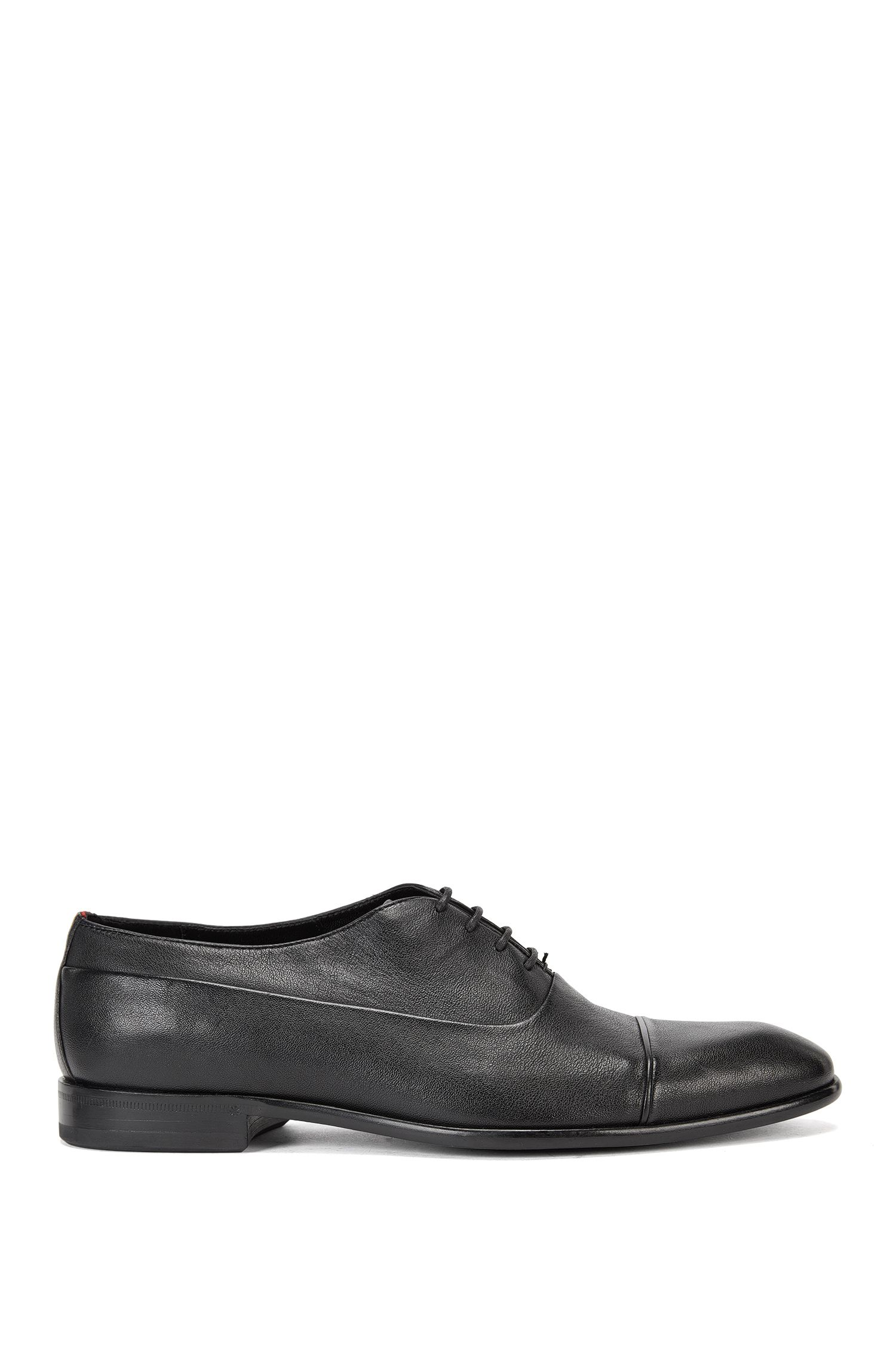 Leather Oxford shoes with piping detail