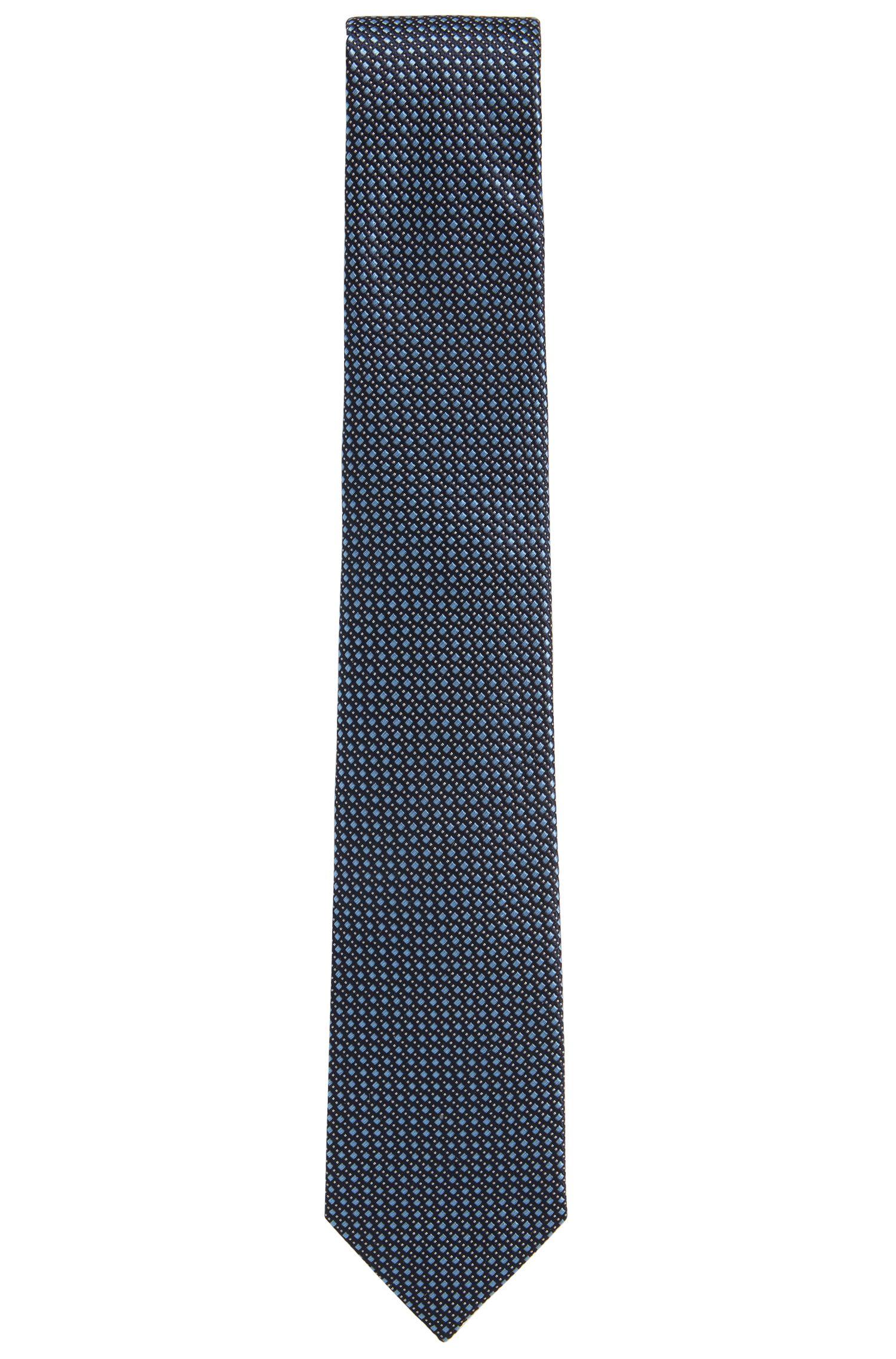 Cravate jacquard confectionnée en Italie, en soie à motif