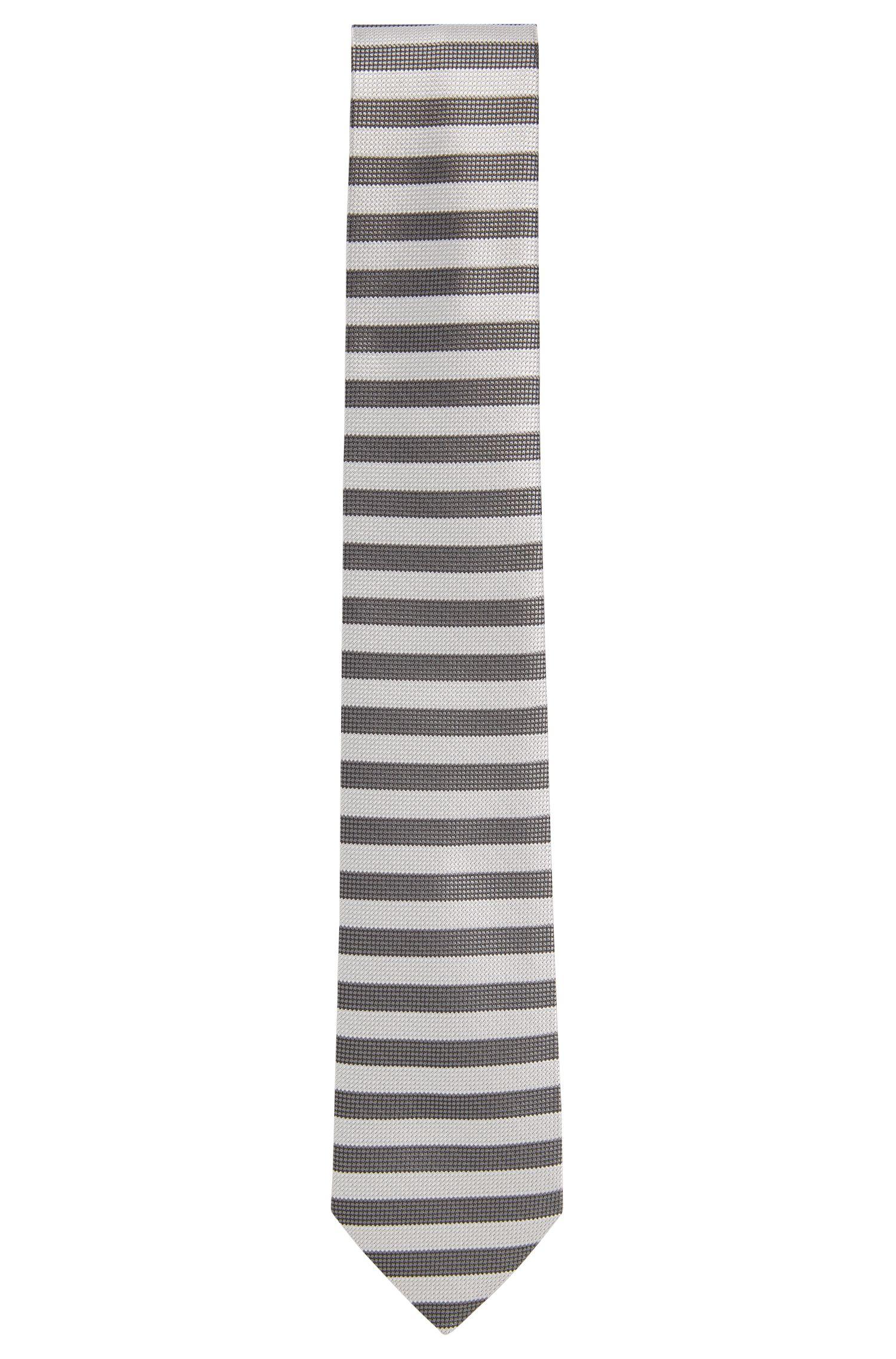 Cravatta jacquard in seta con disegni a contrasto
