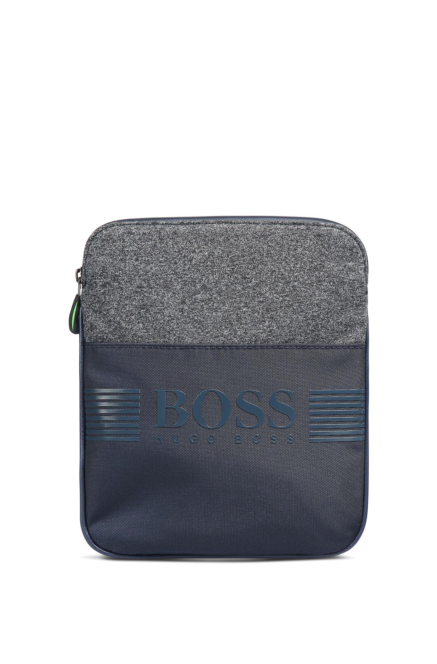 Compacte cross-body tas van jersey en technisch materiaal