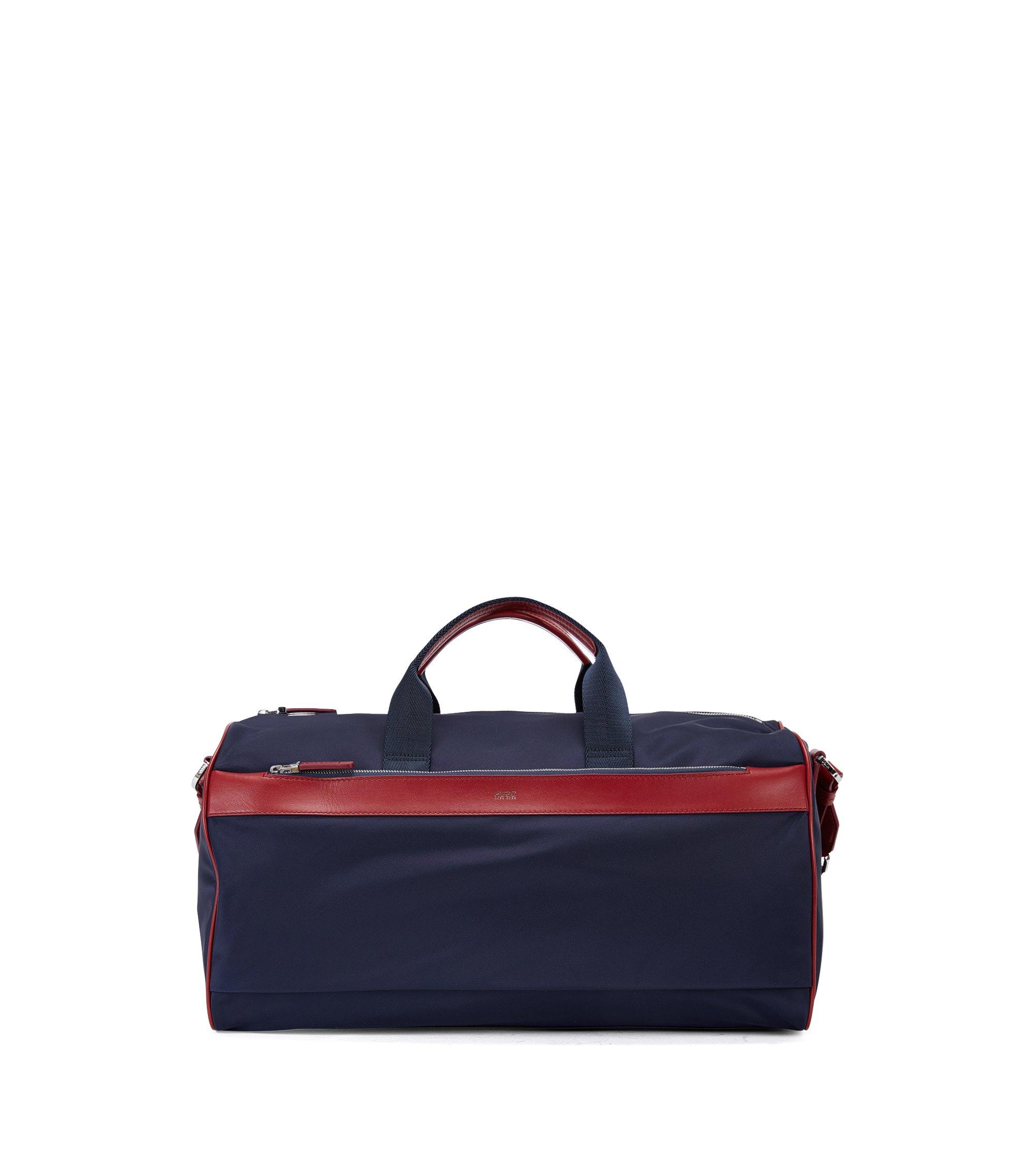Reisetasche aus Material-Mix mit Lederbesatz, Dunkelblau
