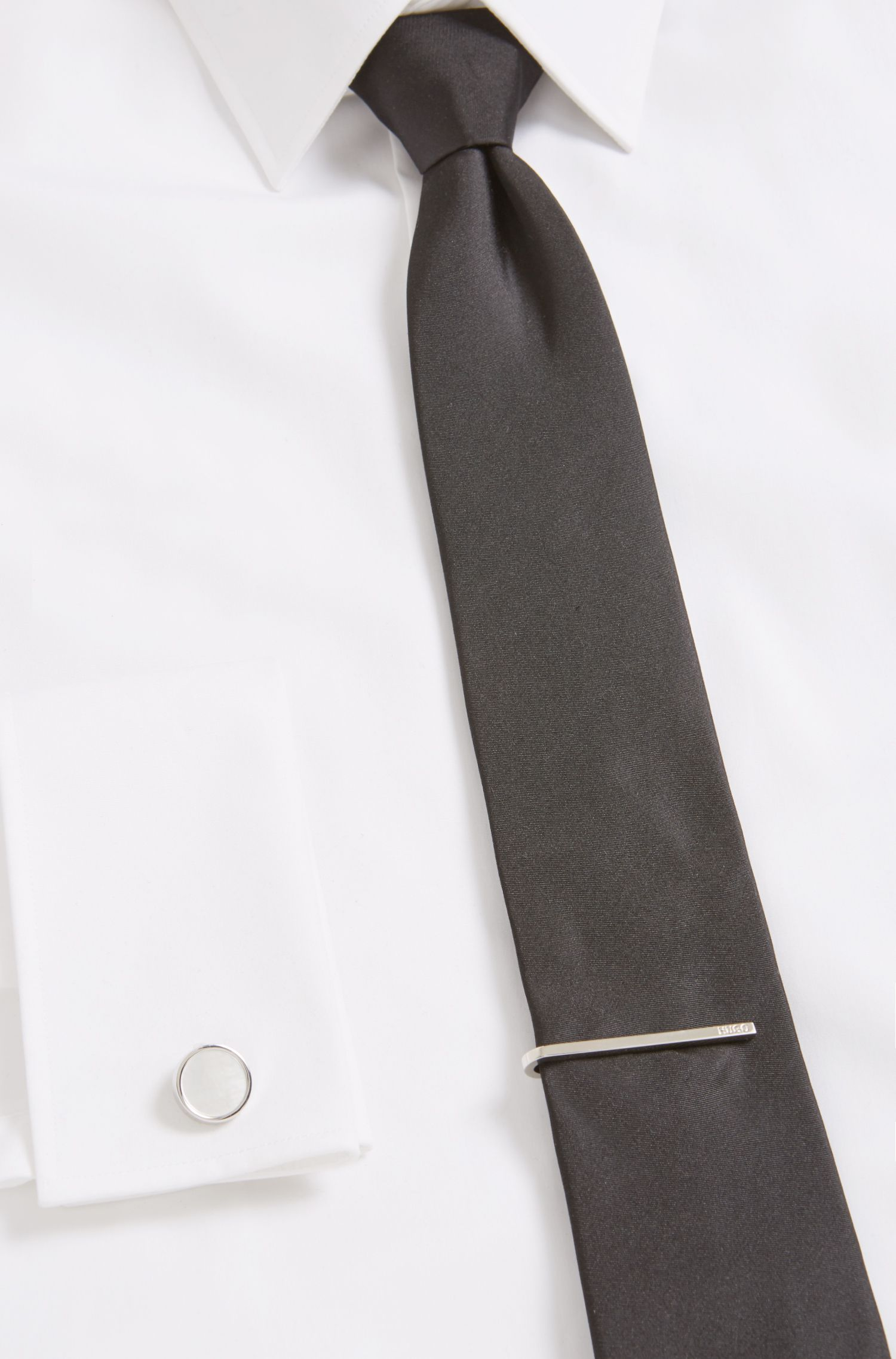 Polished metal tie clip with engraved logo