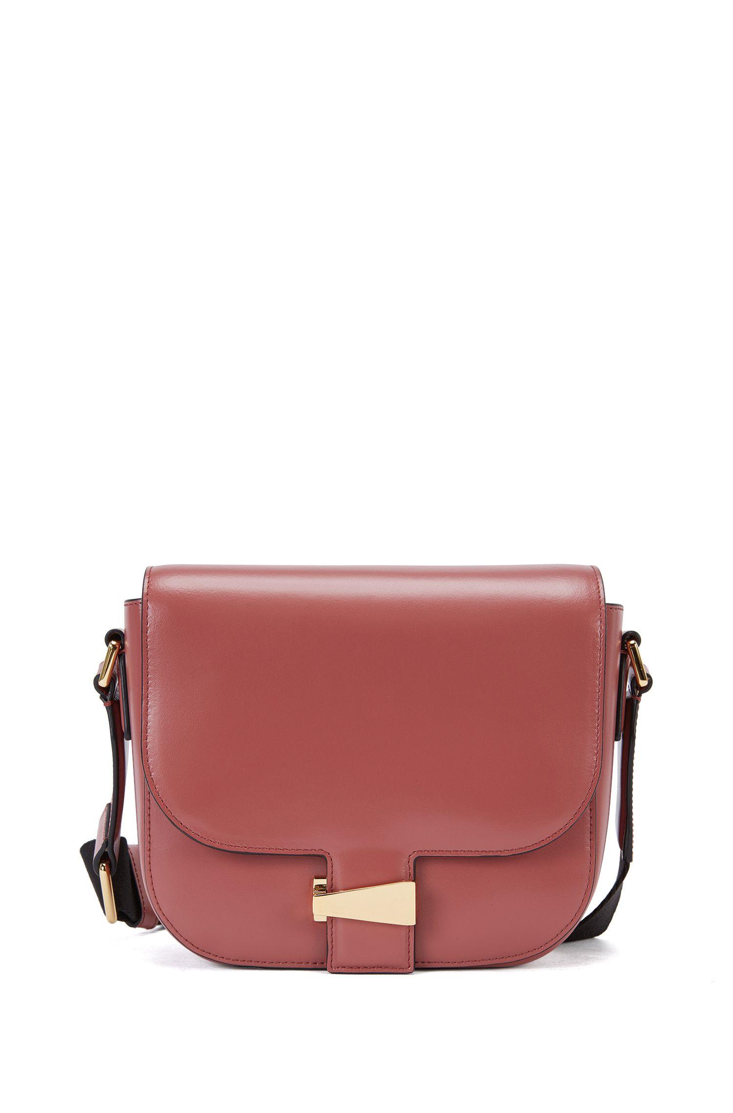 Leather shoulder bag with flap closure