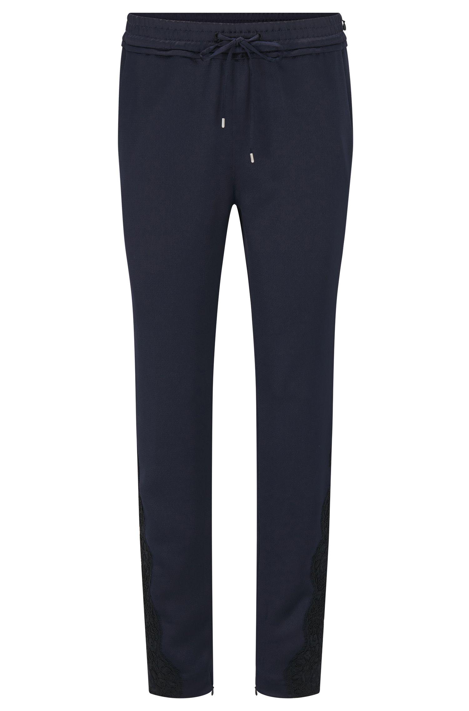 Pantalon Relaxed Fit façon pantalon molletonné avec ceinture froncée