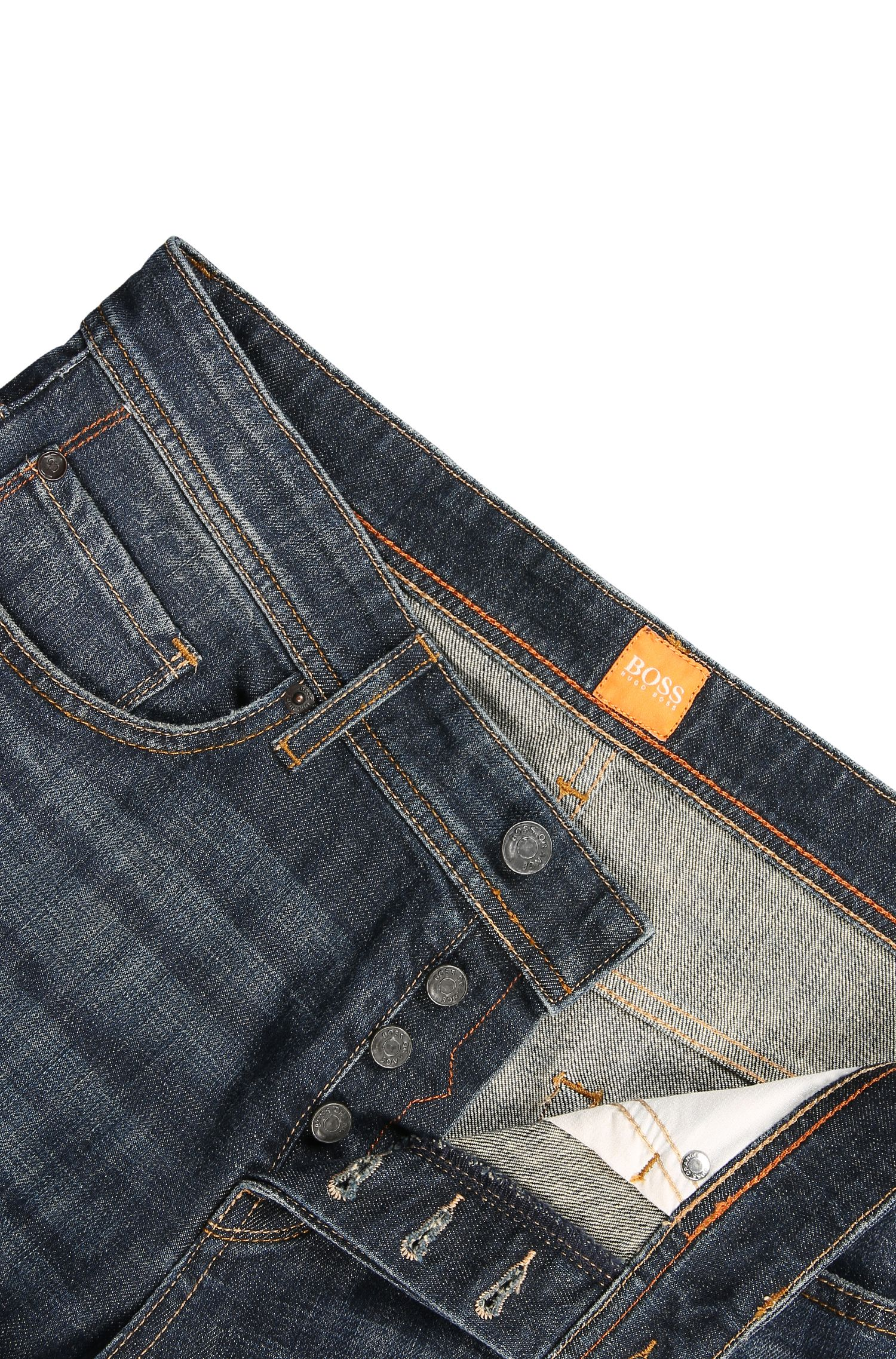 Vaqueros tapered fit en denim elástico compacto