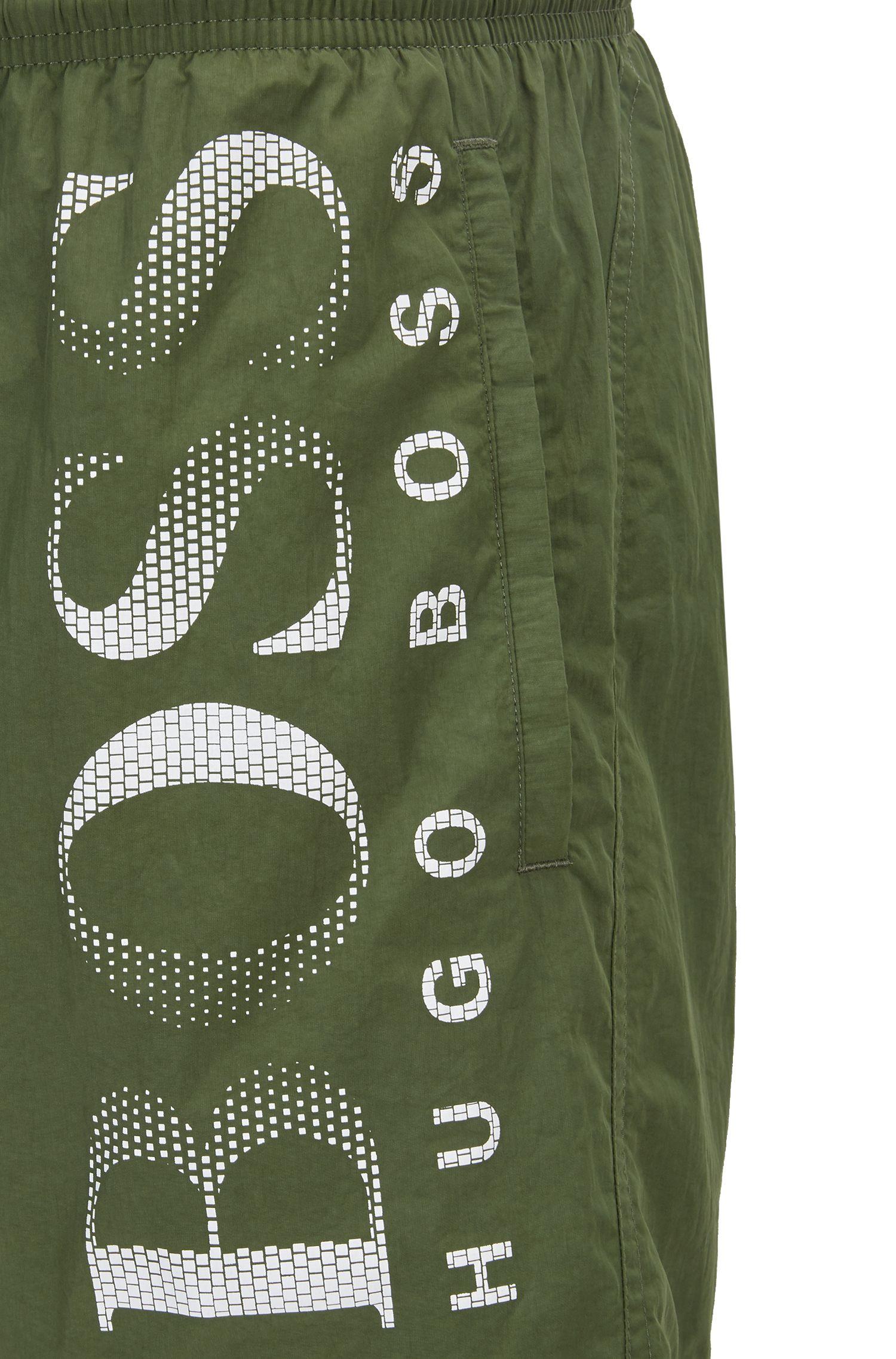 Badeshorts aus Funktionsgewebe mit Logo-Print