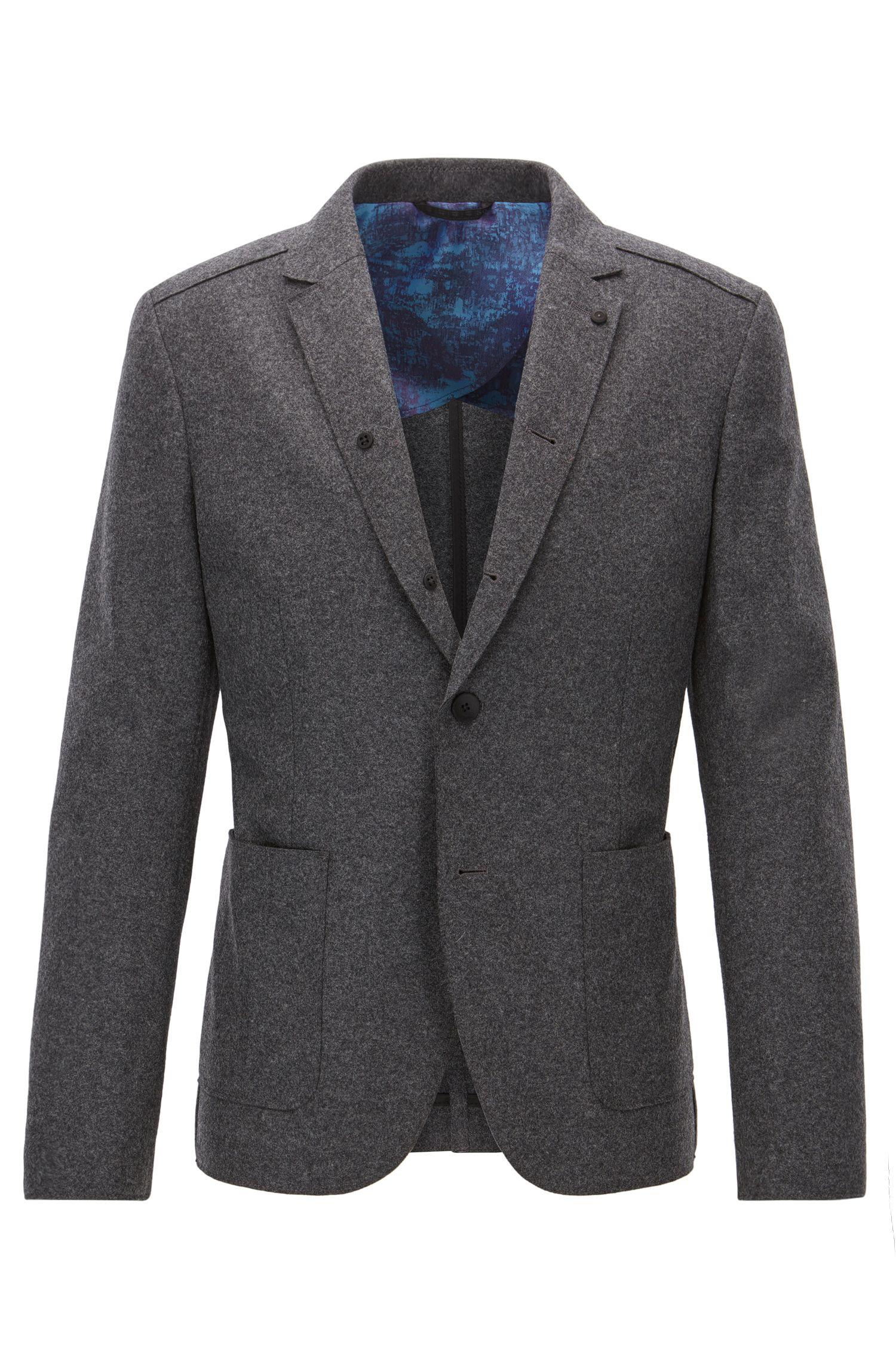 Giacca slim fit in lana vergine con lavorazione a taglio vivo