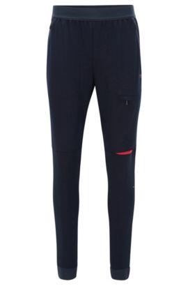 Pantalon Slim Fit en tissu technique stretch, Bleu foncé
