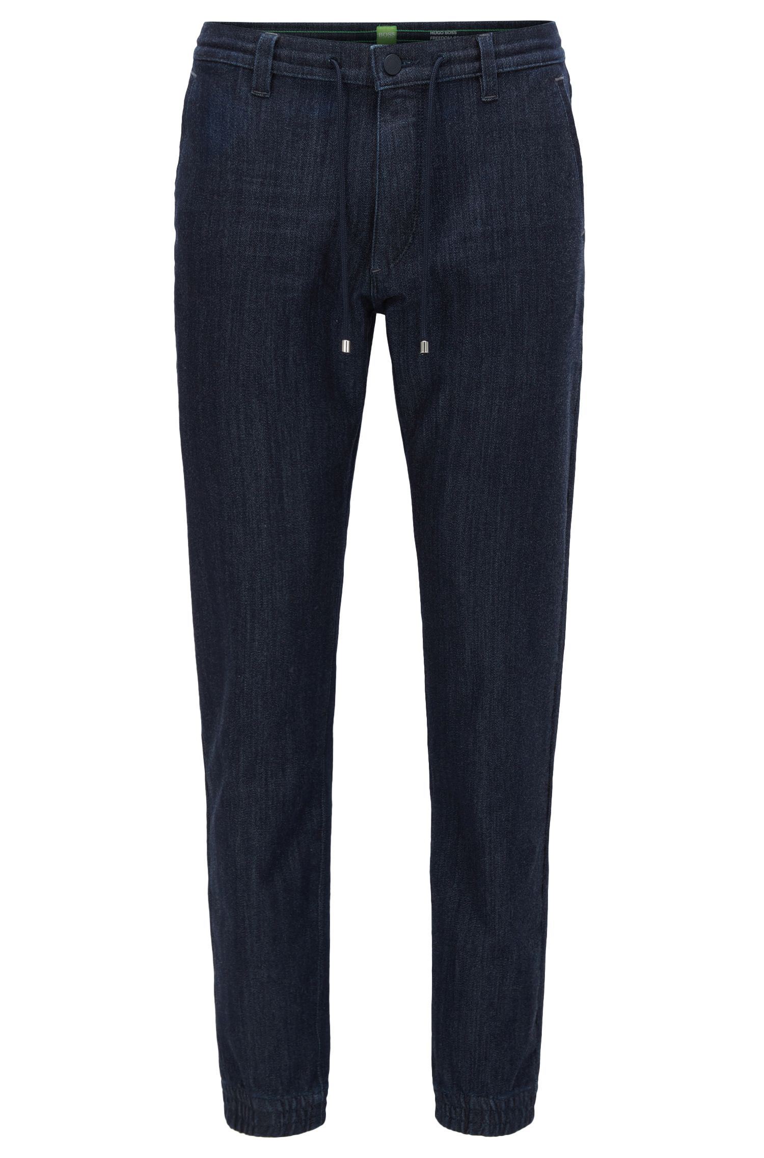 Pantalones tapered fit en denim de punto