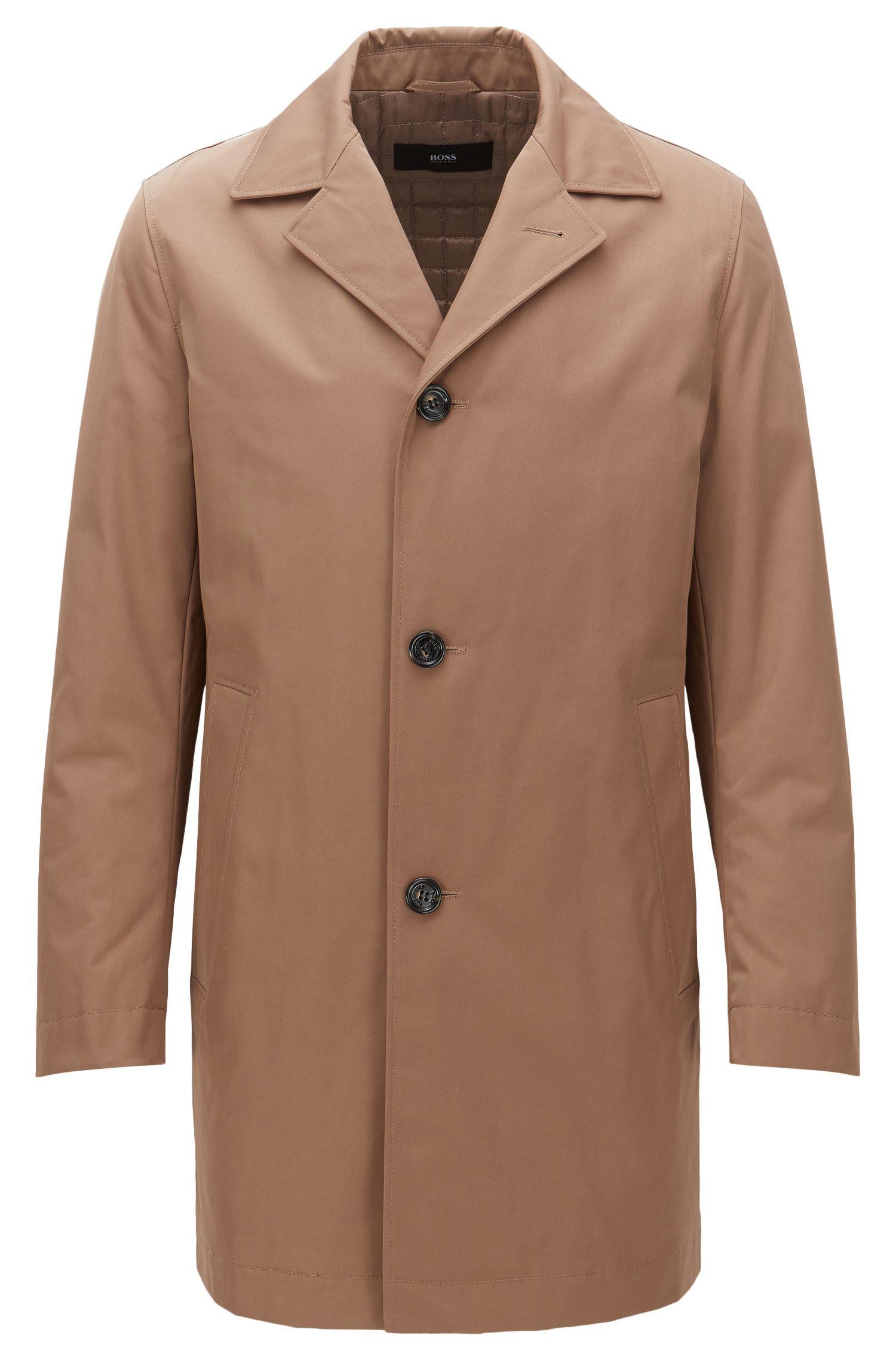 Manteau en tissu de poids moyen, légèrement matelassé