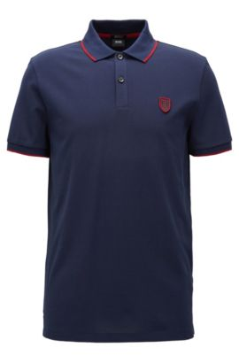 Polo en coton Regular Fit à badge BOSS saisonnier, Bleu foncé