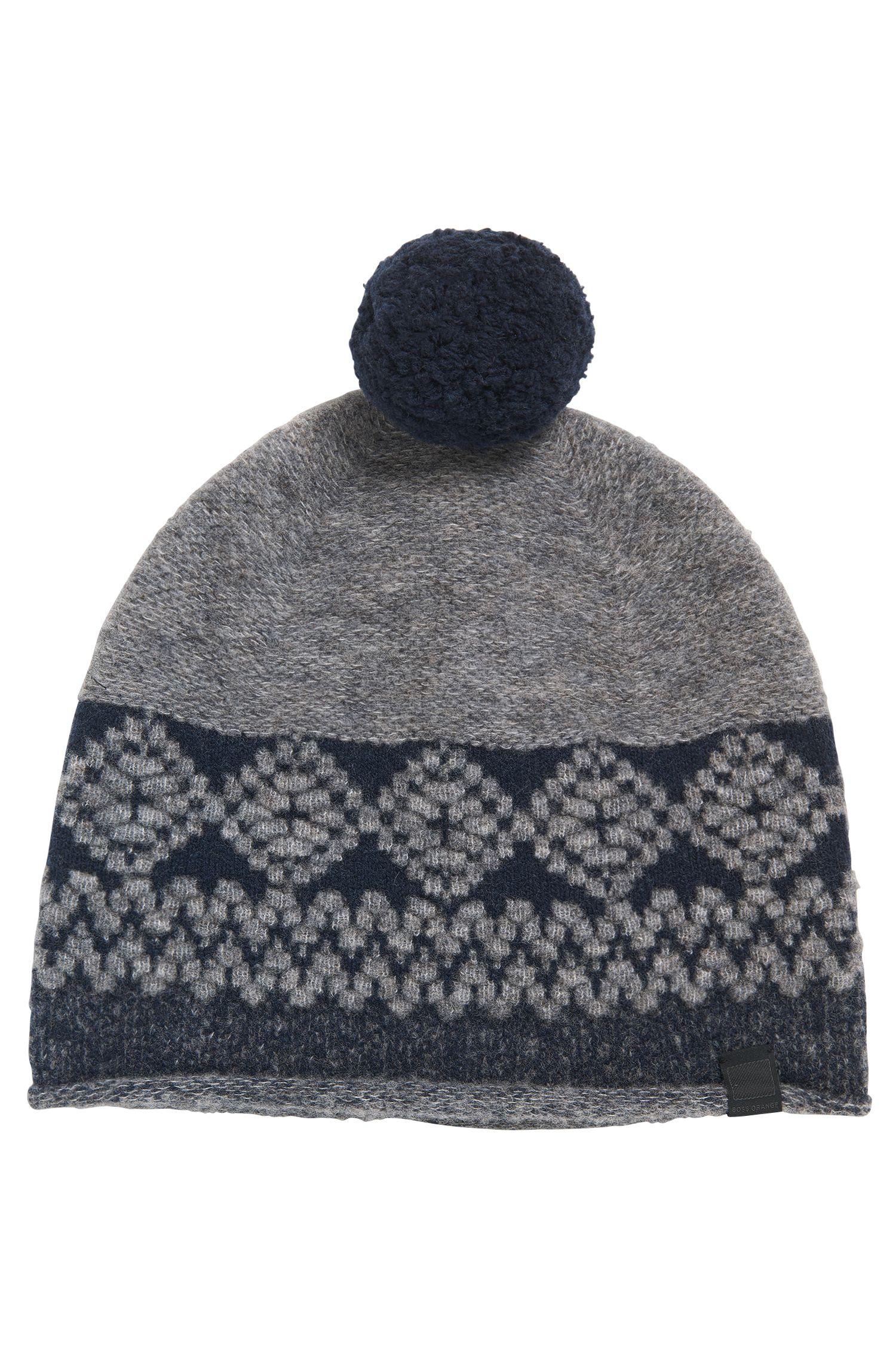Bommelmütze aus Schurwoll-Mix mit Wolle