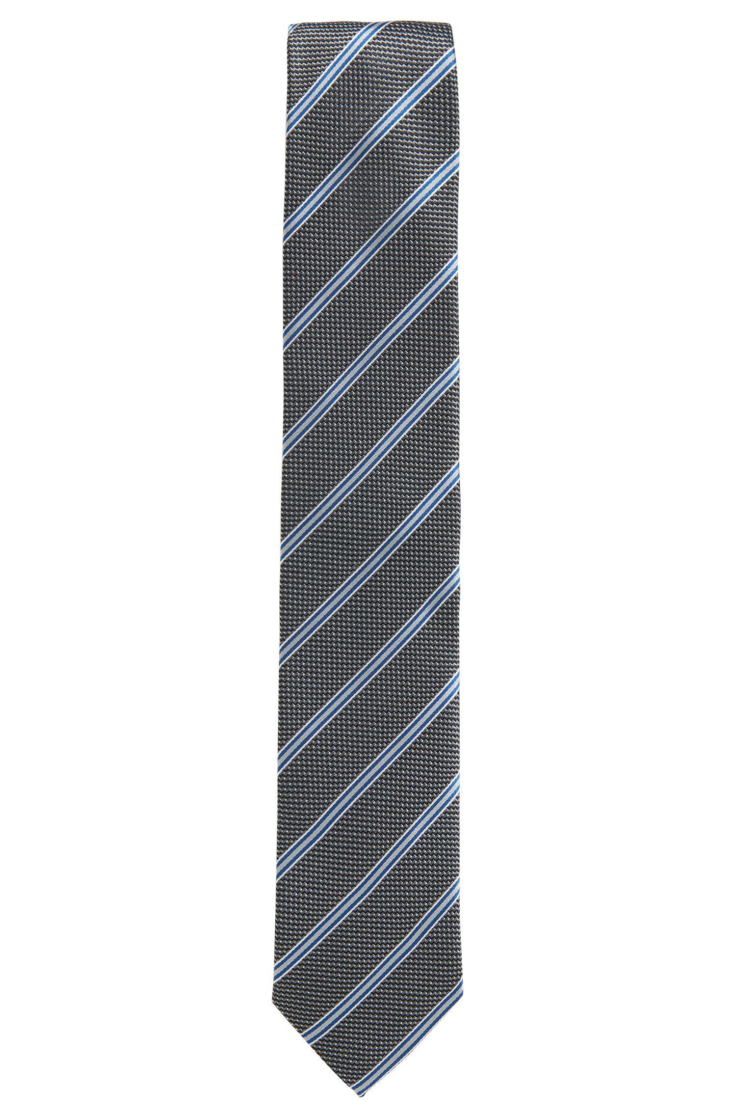 Cravatta a righe con motivo a microdisegni in seta jacquard