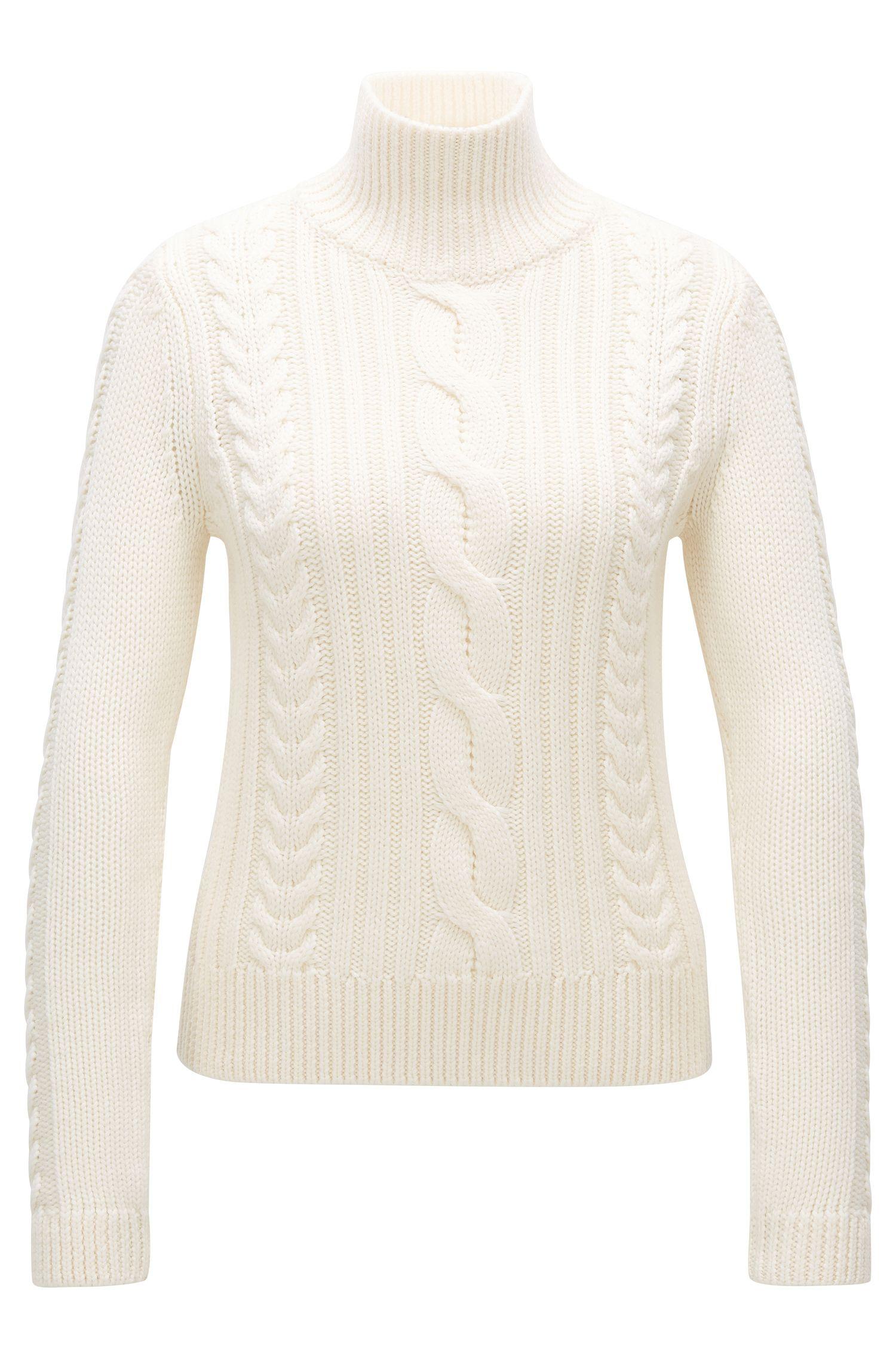 Maglione in lana merino con colletto a tartaruga e lavorazione a treccia