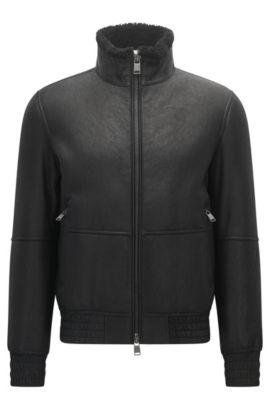 Regular-fit jas van lamsleer met elastische details, Zwart