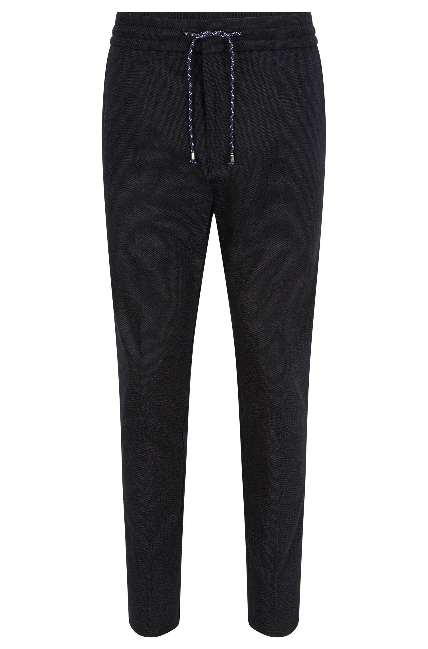 Pantalon Tapered Fit en coton mélangé avec cordon de serrage à la taille.