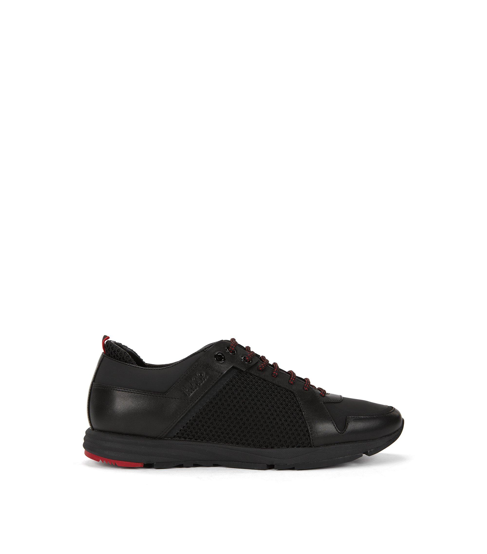 Sneakers aus Leder und Material-Mix, Schwarz