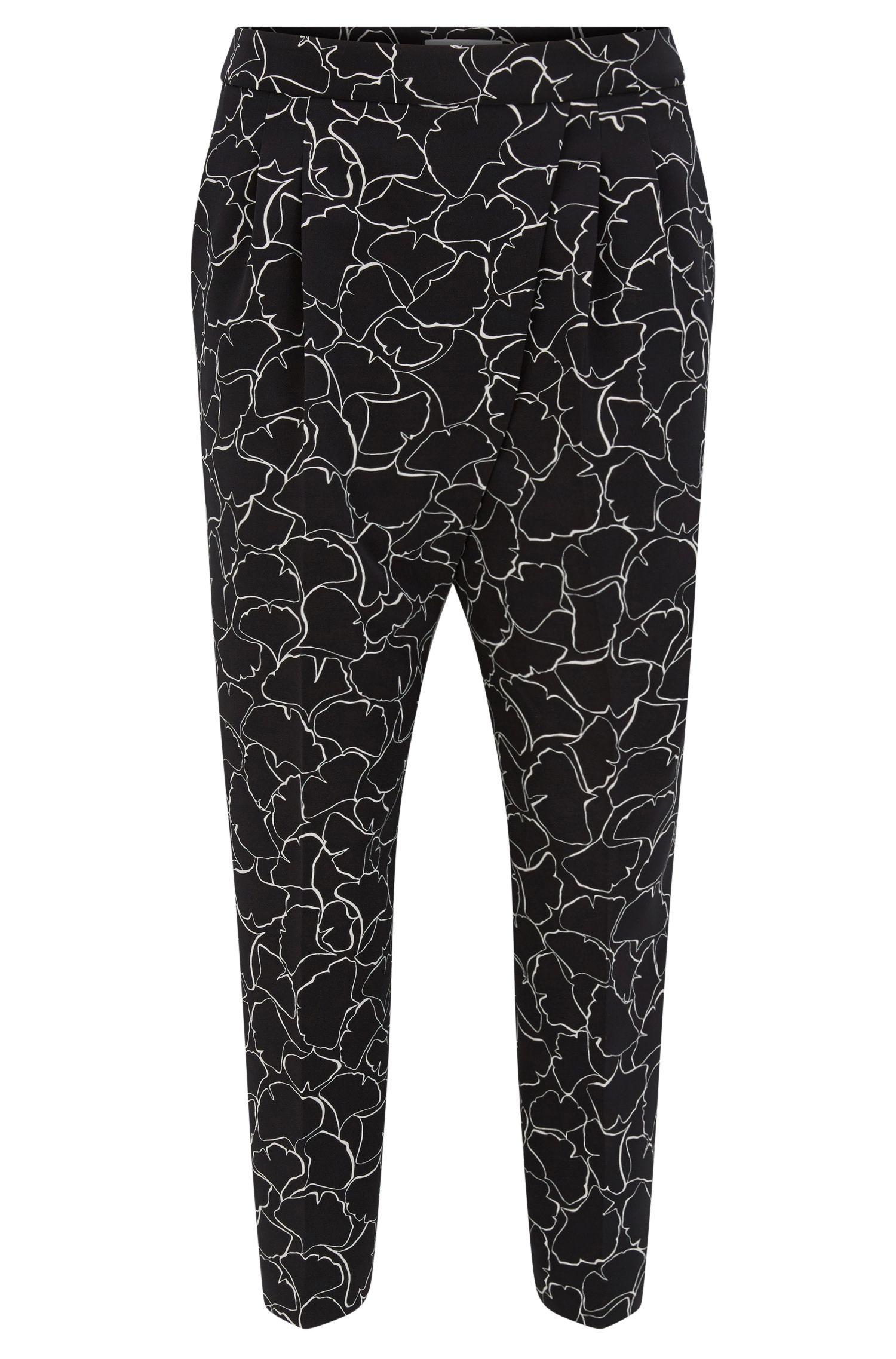 Pantalones tobilleros relaxed fit en tejido elástico