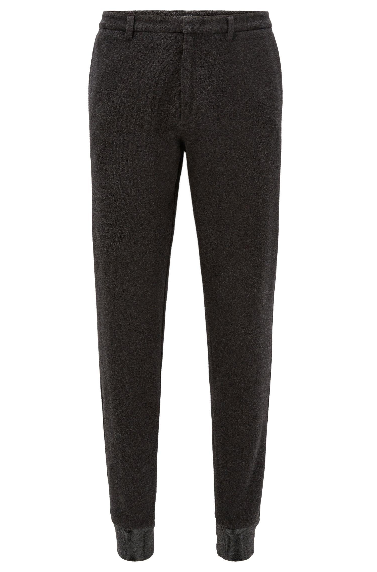 Pantalones slim fit en algodón cepillado con puños