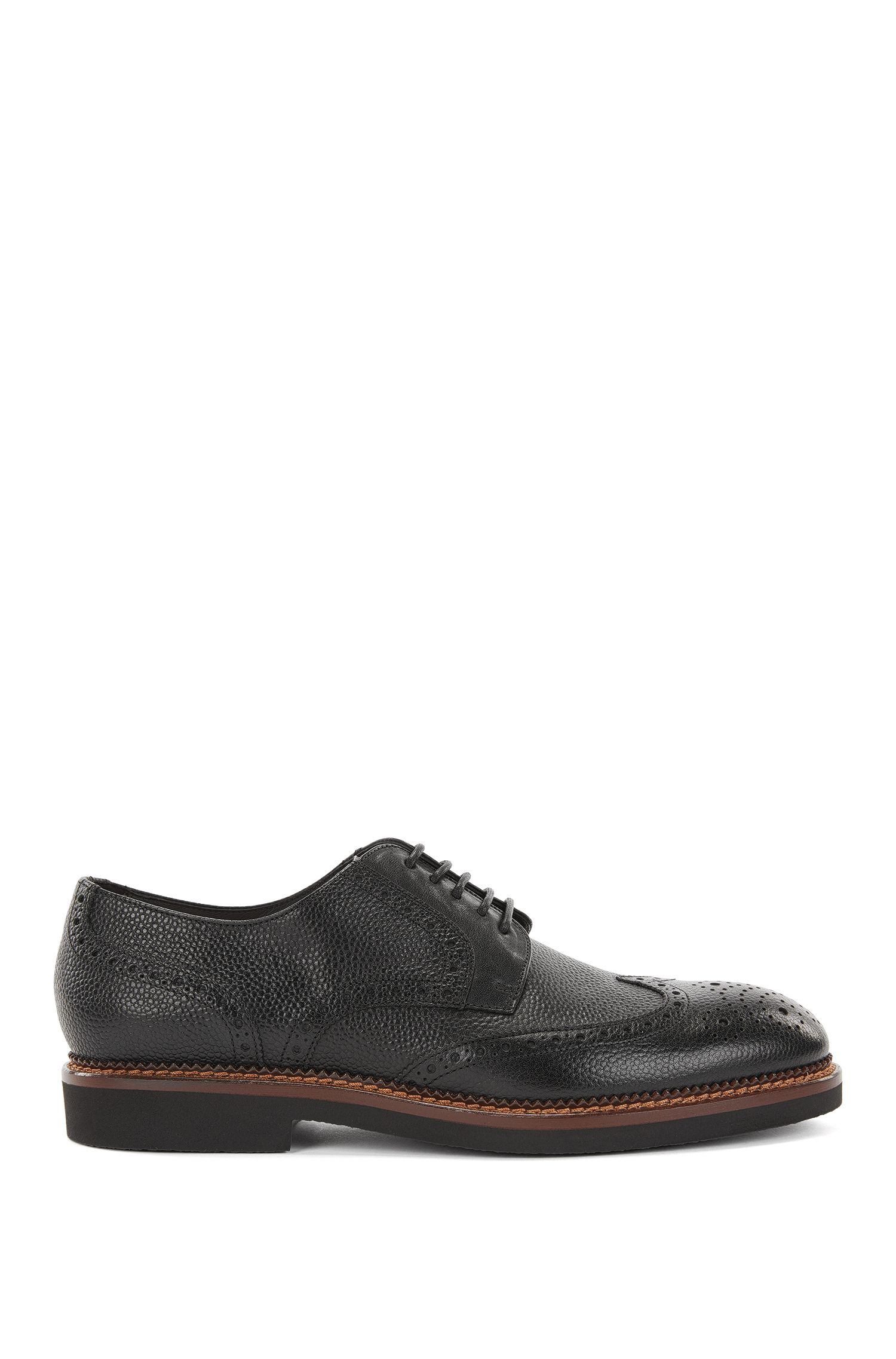 Lace-up brogue shoes in grained leather