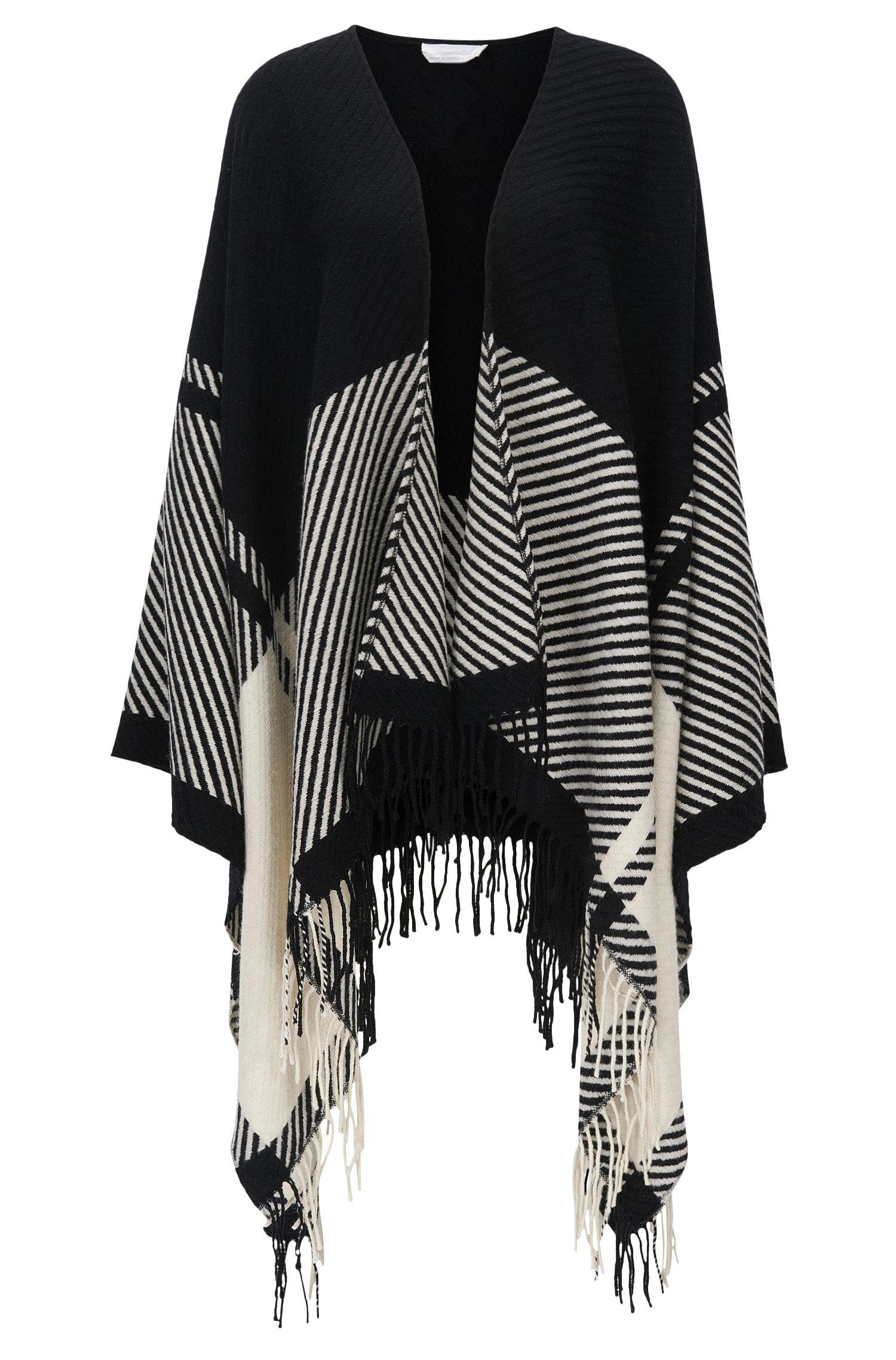Poncho en laine mélangée, à motif graphique et franges