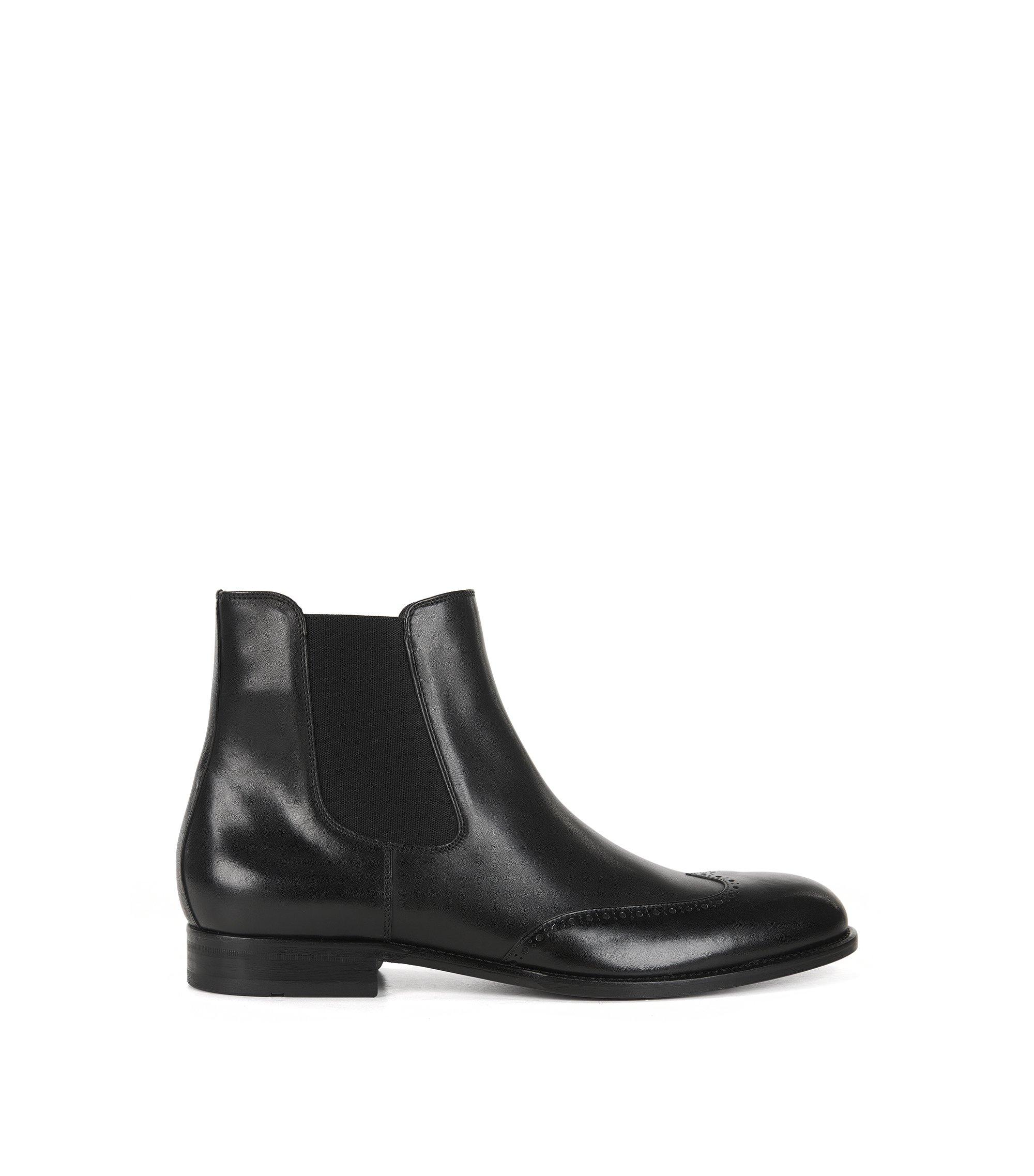 Chelsea Boots aus Leder mit verzierten Flügelkappen, Schwarz