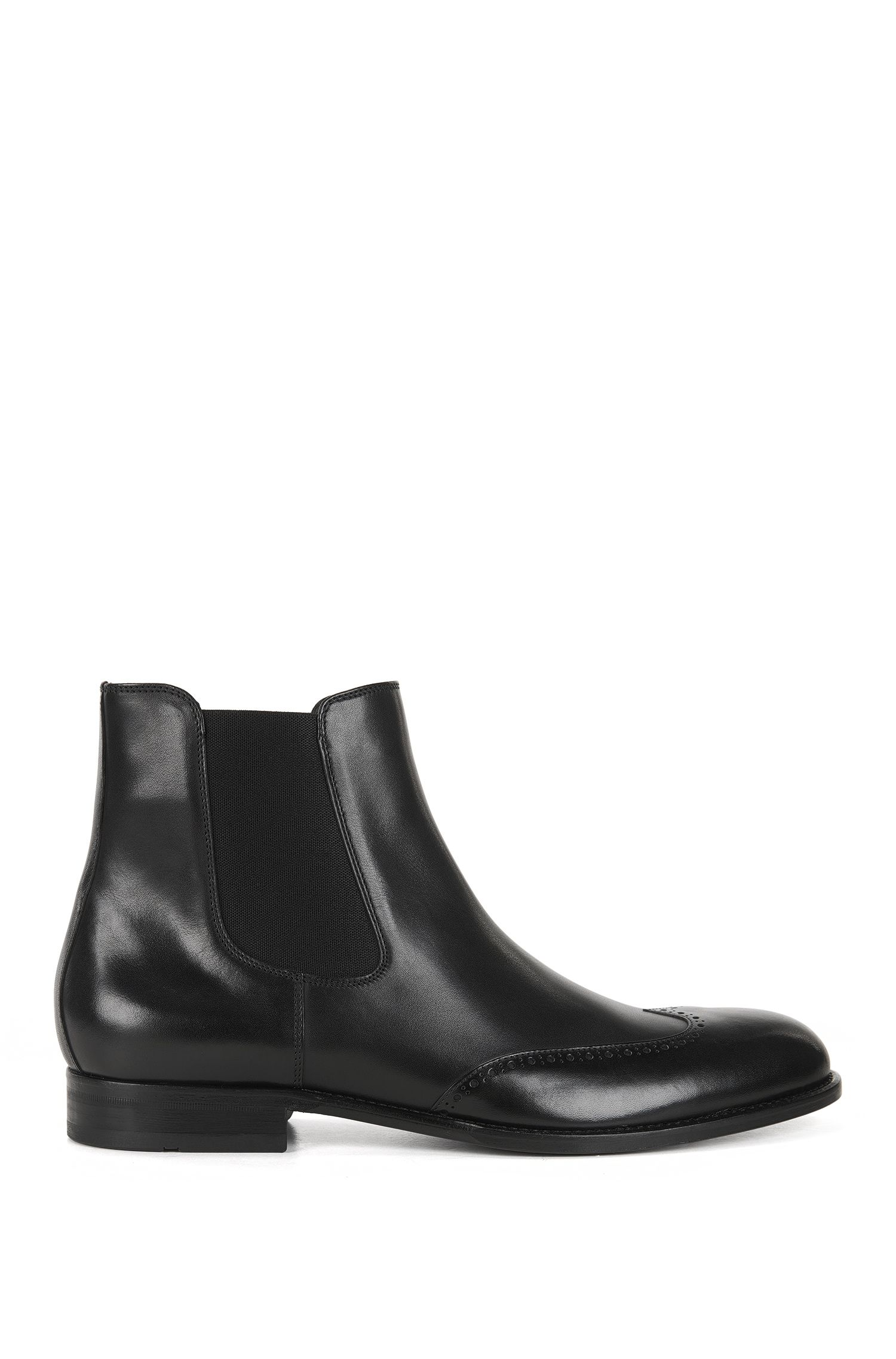 Leather Chelsea boots with wingtip details