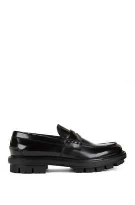 Leather penny loafers with a rubber lug sole, Black
