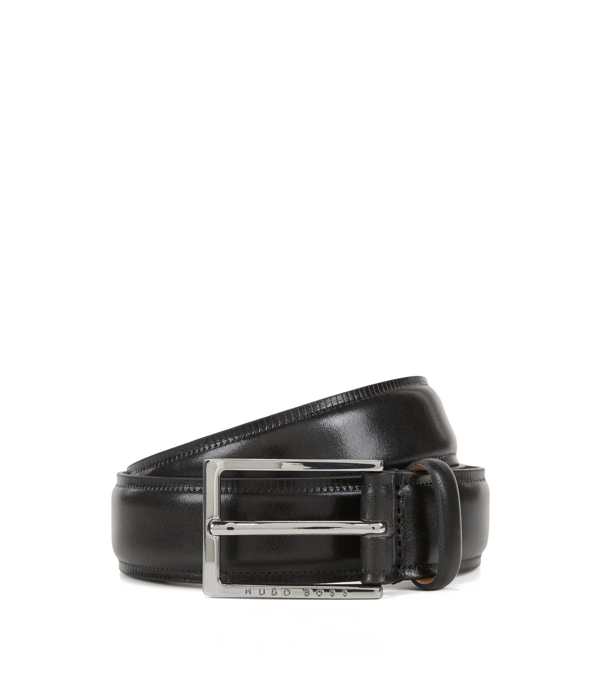 Gürtel aus pflanzlich gegerbtem Leder mit kontrastfarbenen Kanten , Schwarz