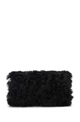 Manicotto in shearling con catenella, Nero