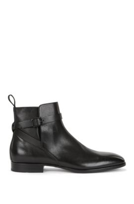Grained leather Chelsea boots with buckled ankle strap, Black