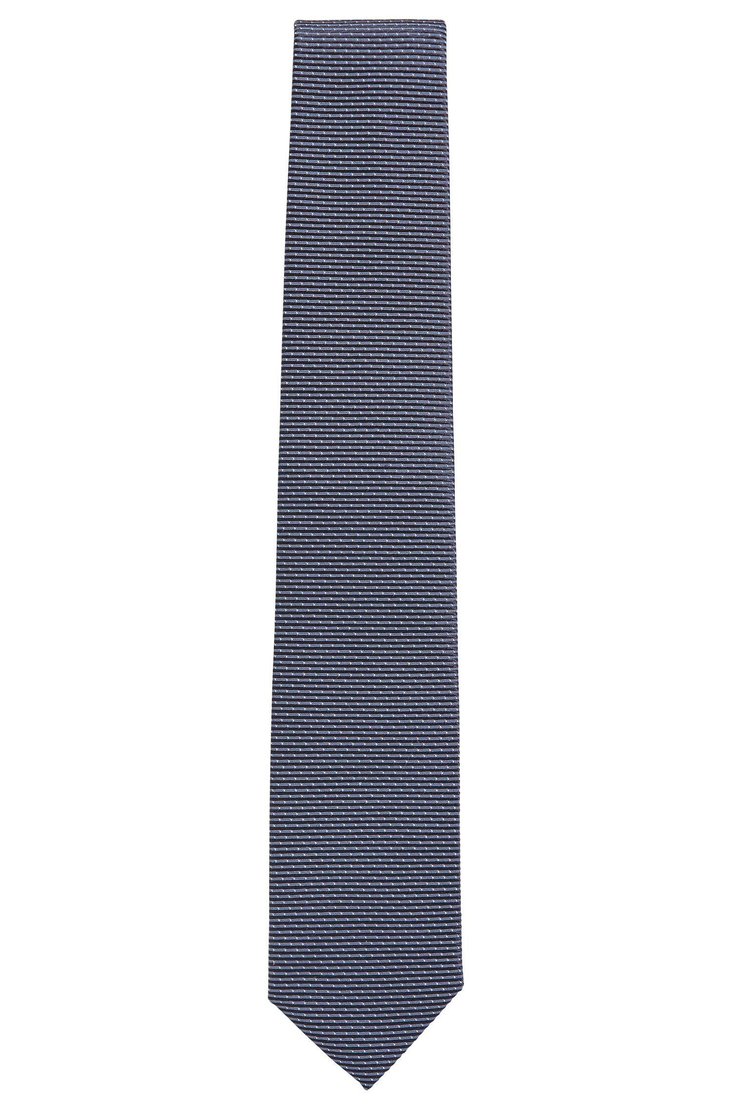 Cravate en jacquard de soie à micro-motif